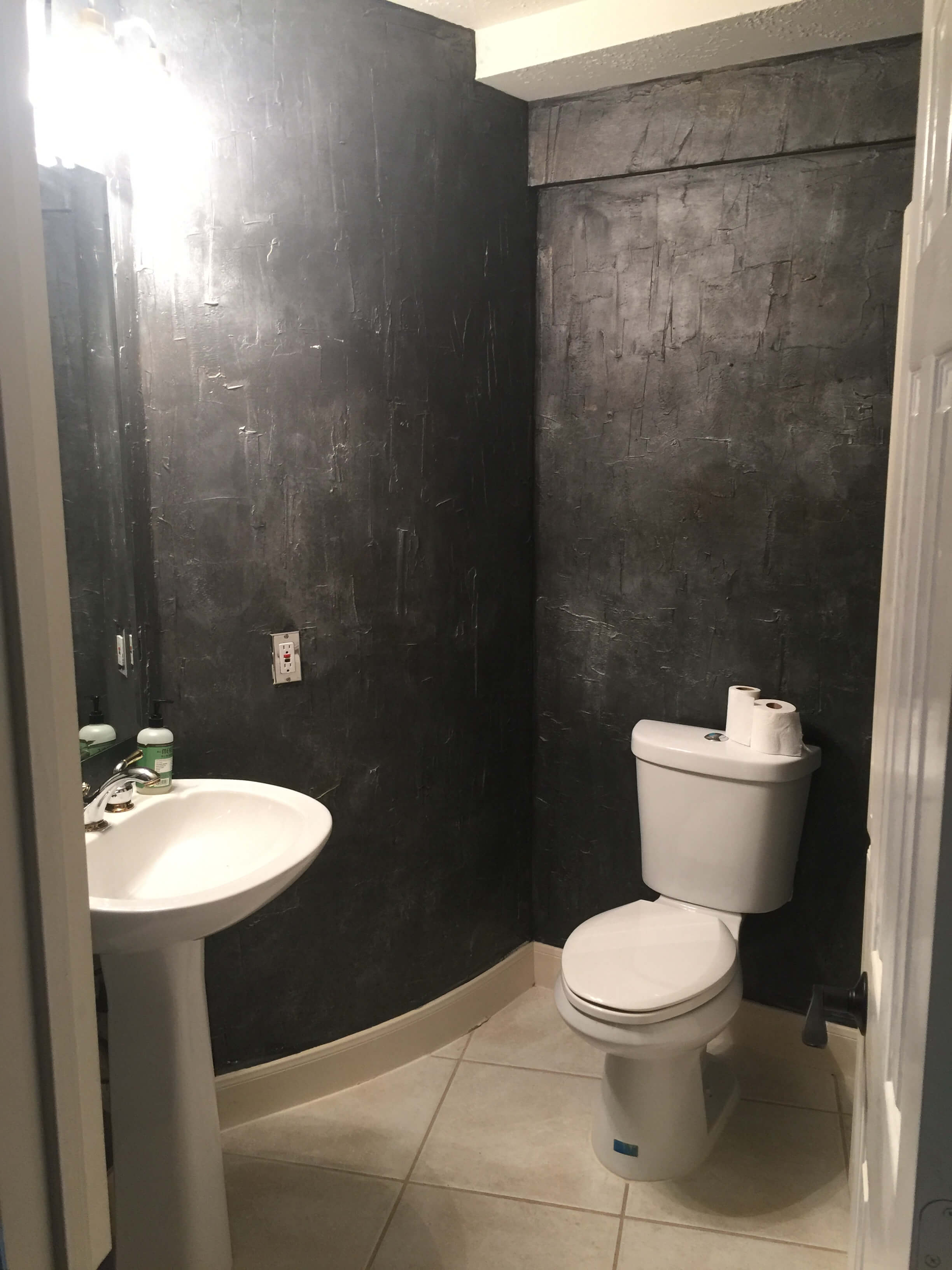 BEFORE pic - Powder room with heavy, dark textured walls