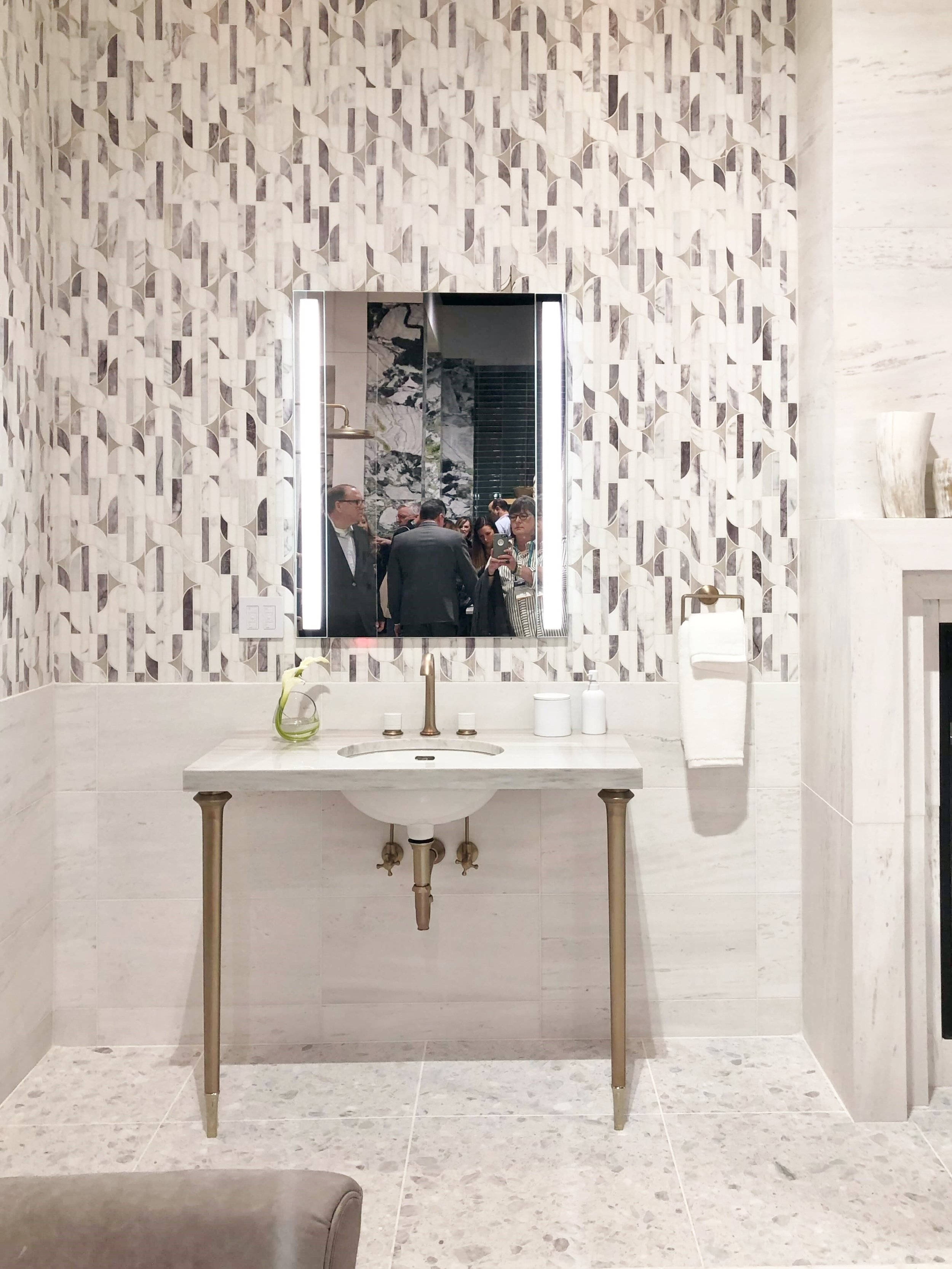 Walls of mosaic marble tile shown at Ann Sacks booth, KBIS 2019 Surfaces Trends