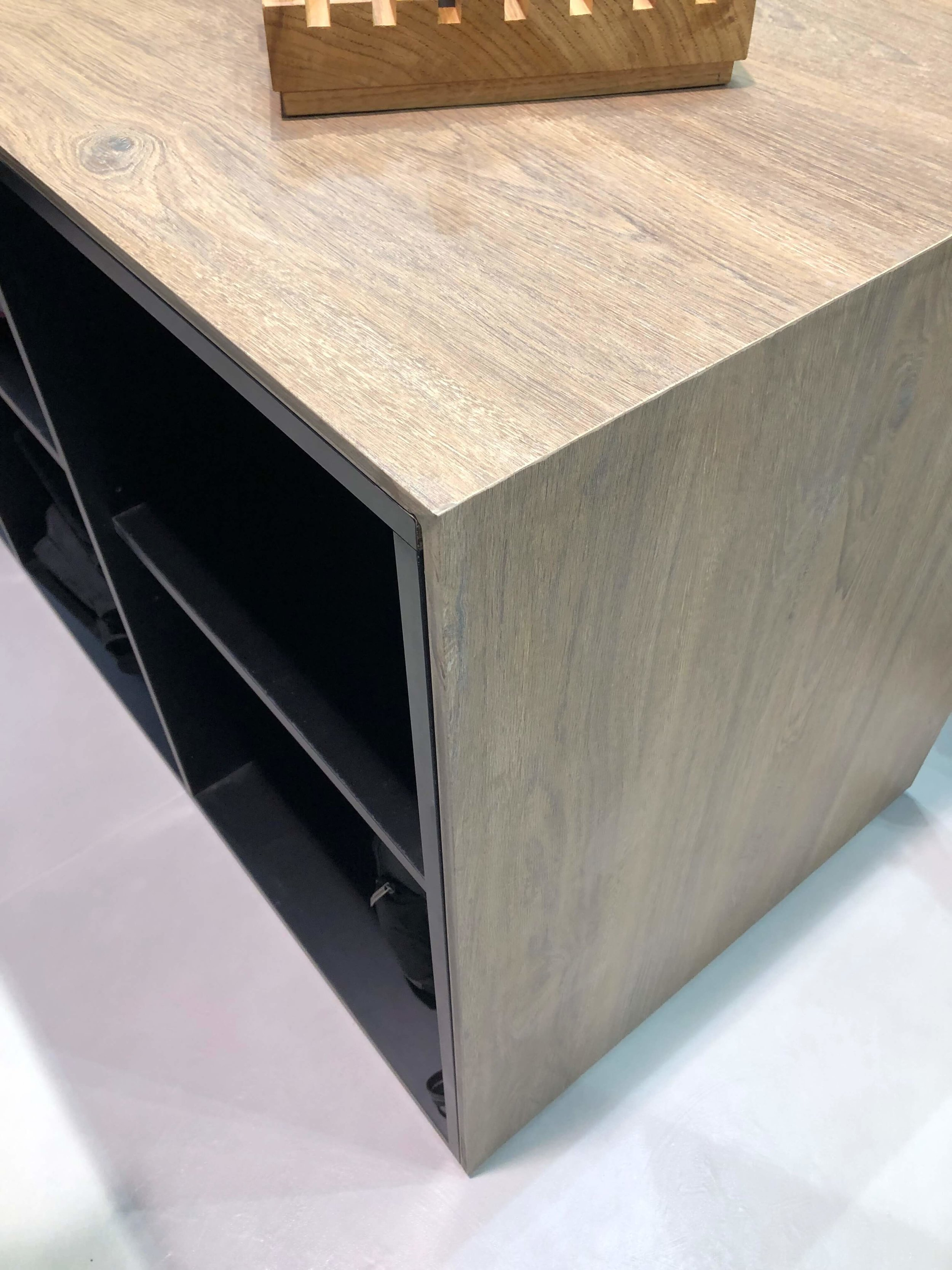 Mitered edge on wood look porcelain slab countertop with waterfall edge from Sapienstone |KBIS 2019 Surfaces Trends