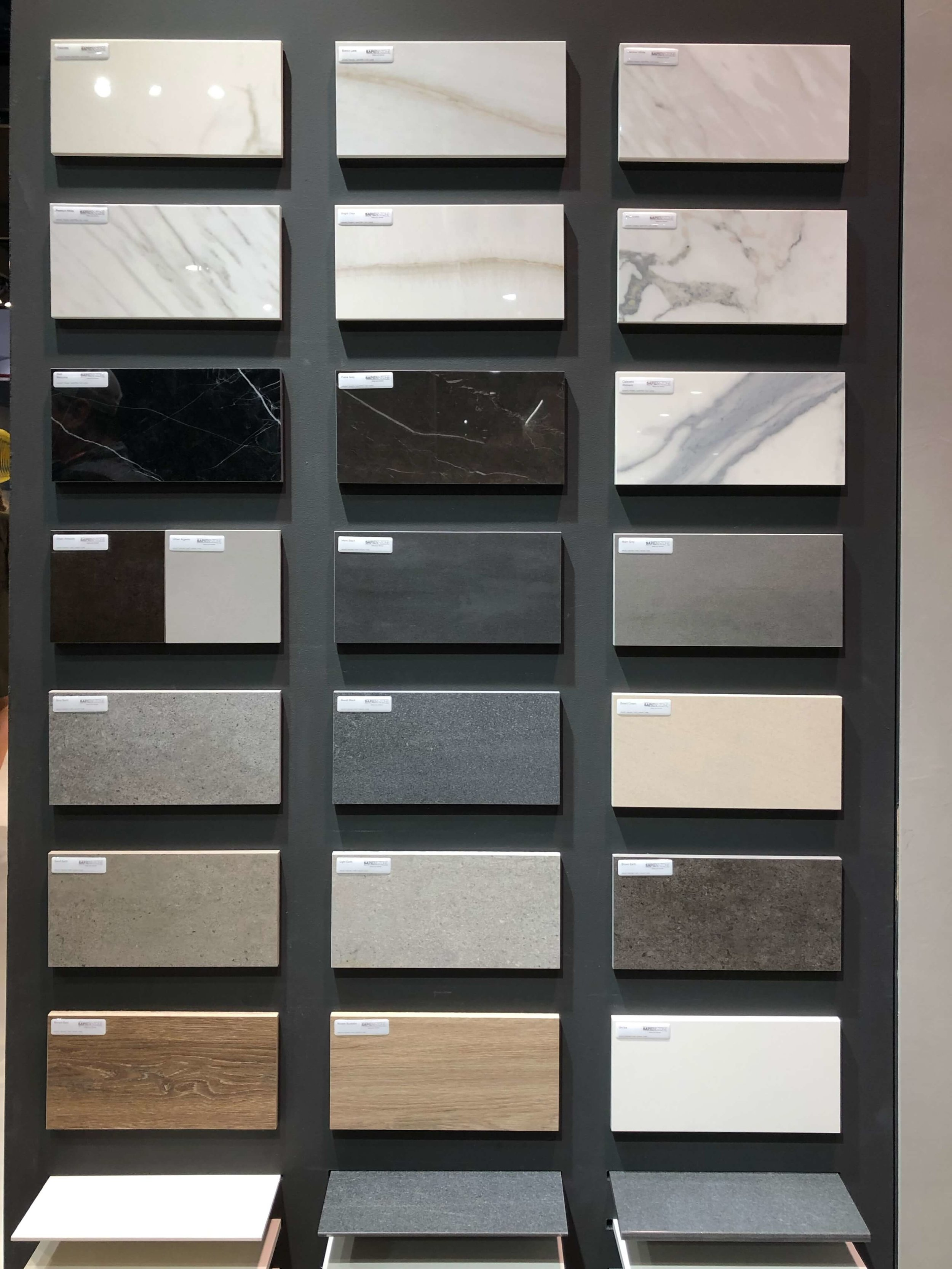 Wall of samples of Sapienstone porcelain slabs | KBIS 2019 Surfaces Trends