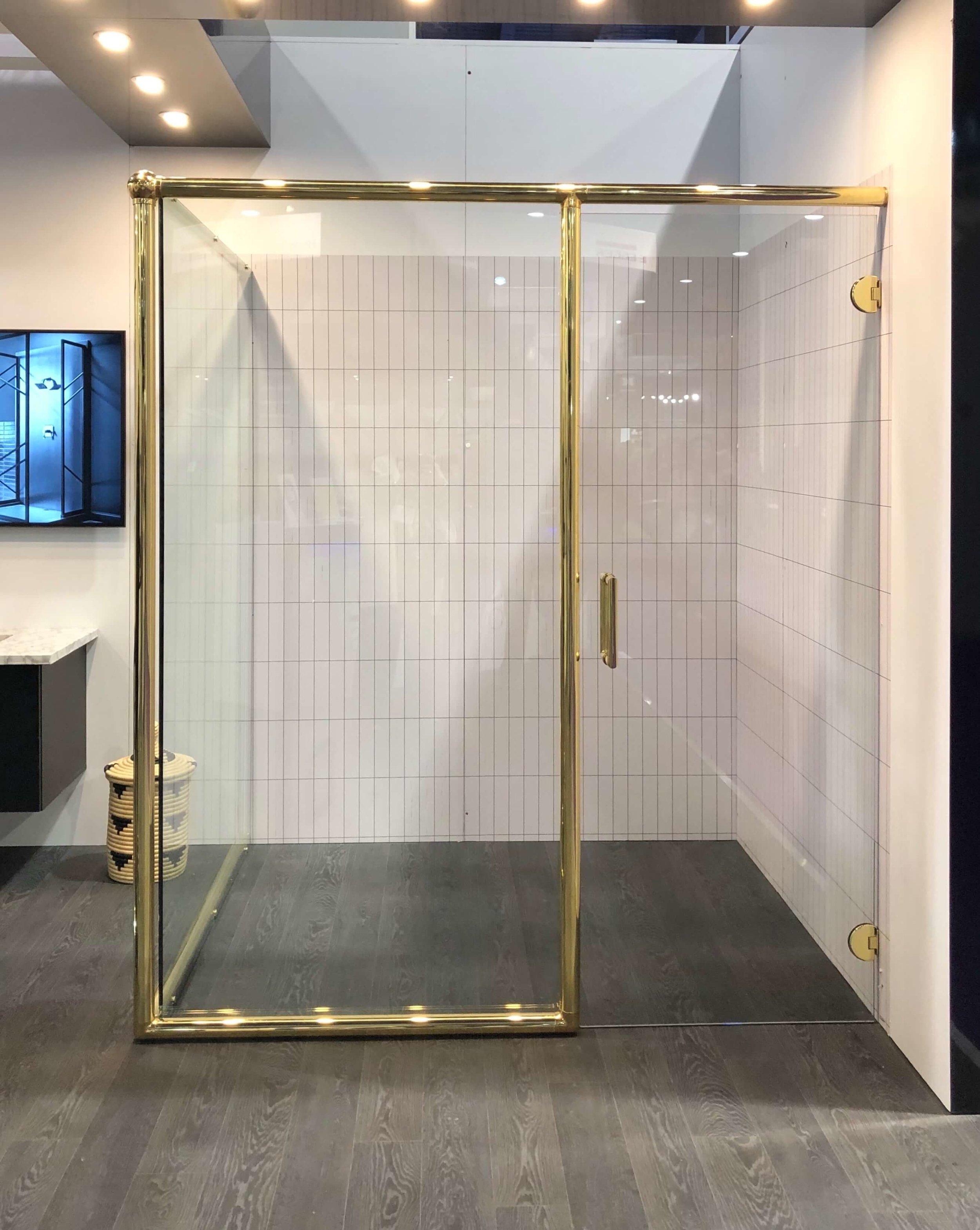 Vintage brass look glass shower enclosure | KBIS 2019 Surfaces Trends