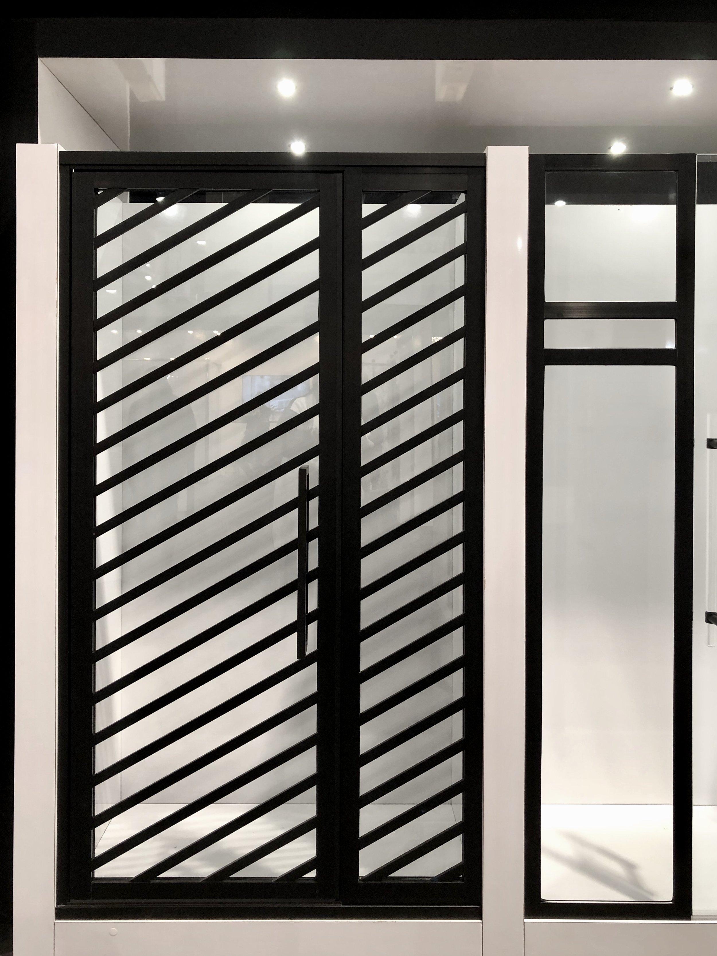 Coastal Shower Doors modern look black framing shower enclosure | KBIS 2019 Surfaces Trends