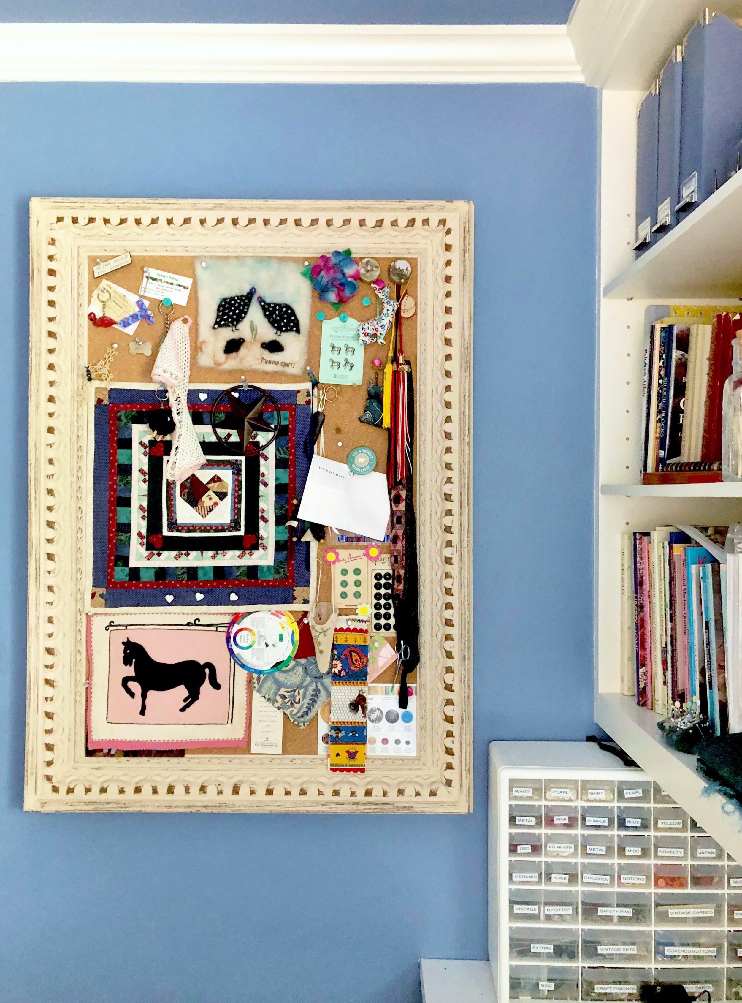 Periwinkle blue sewing room | Craft room organization, framed tackboard