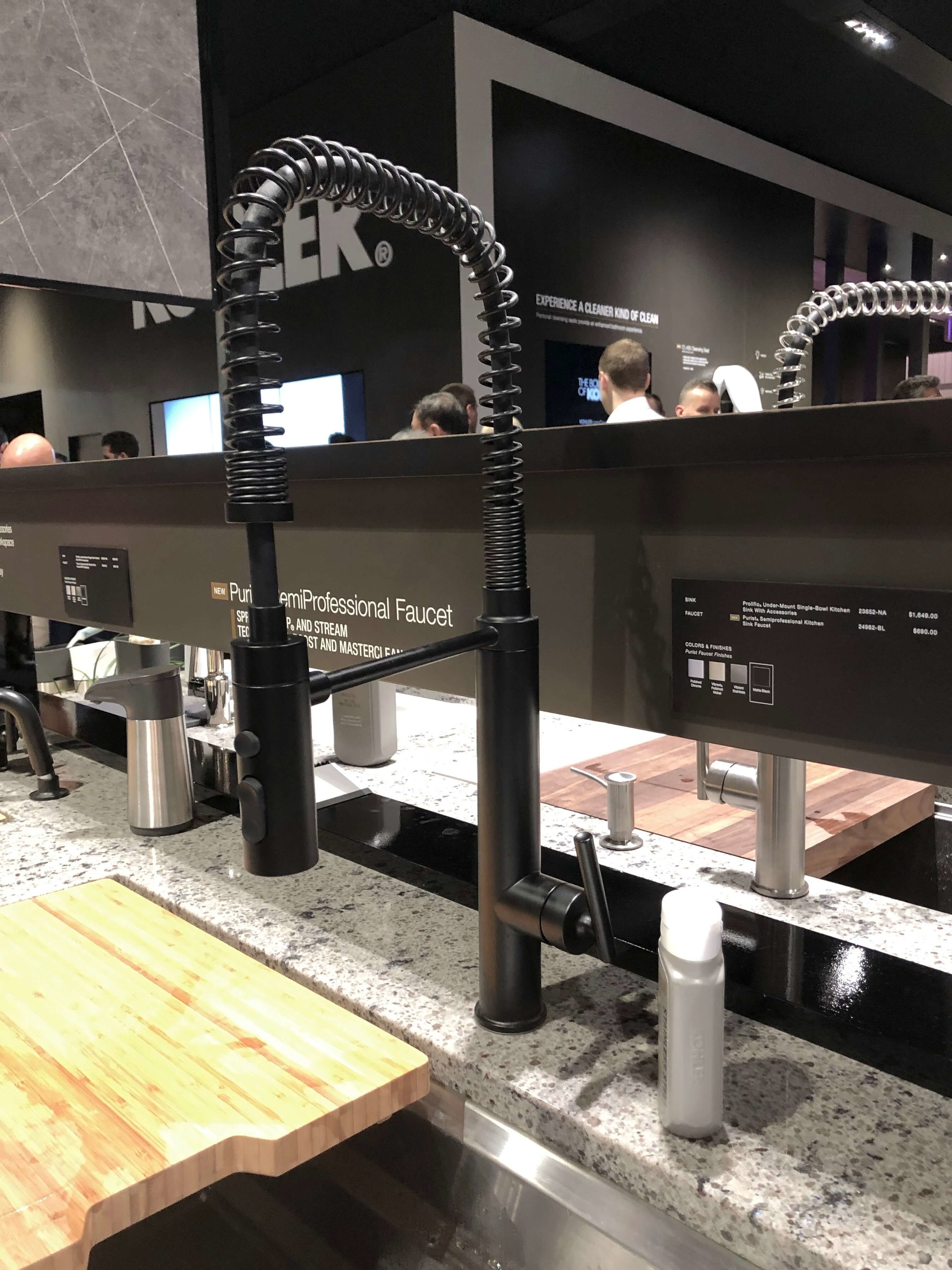 Black kitchen faucet seen at Kohler booth, KBIS 2019 | Black Faucets
