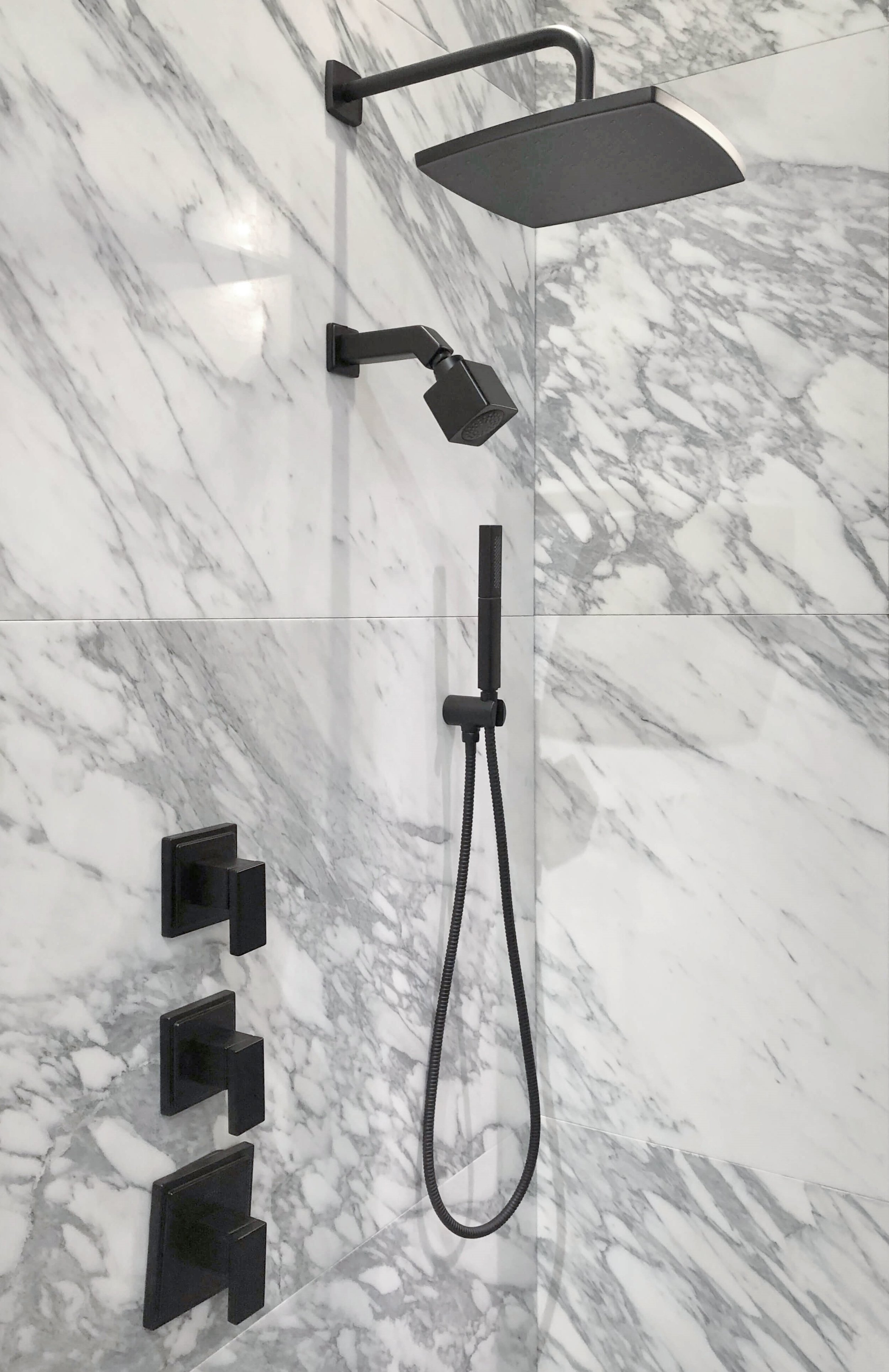Black Shower Fixtures on white marble tile seen at Kohler booth | KBIS 2019