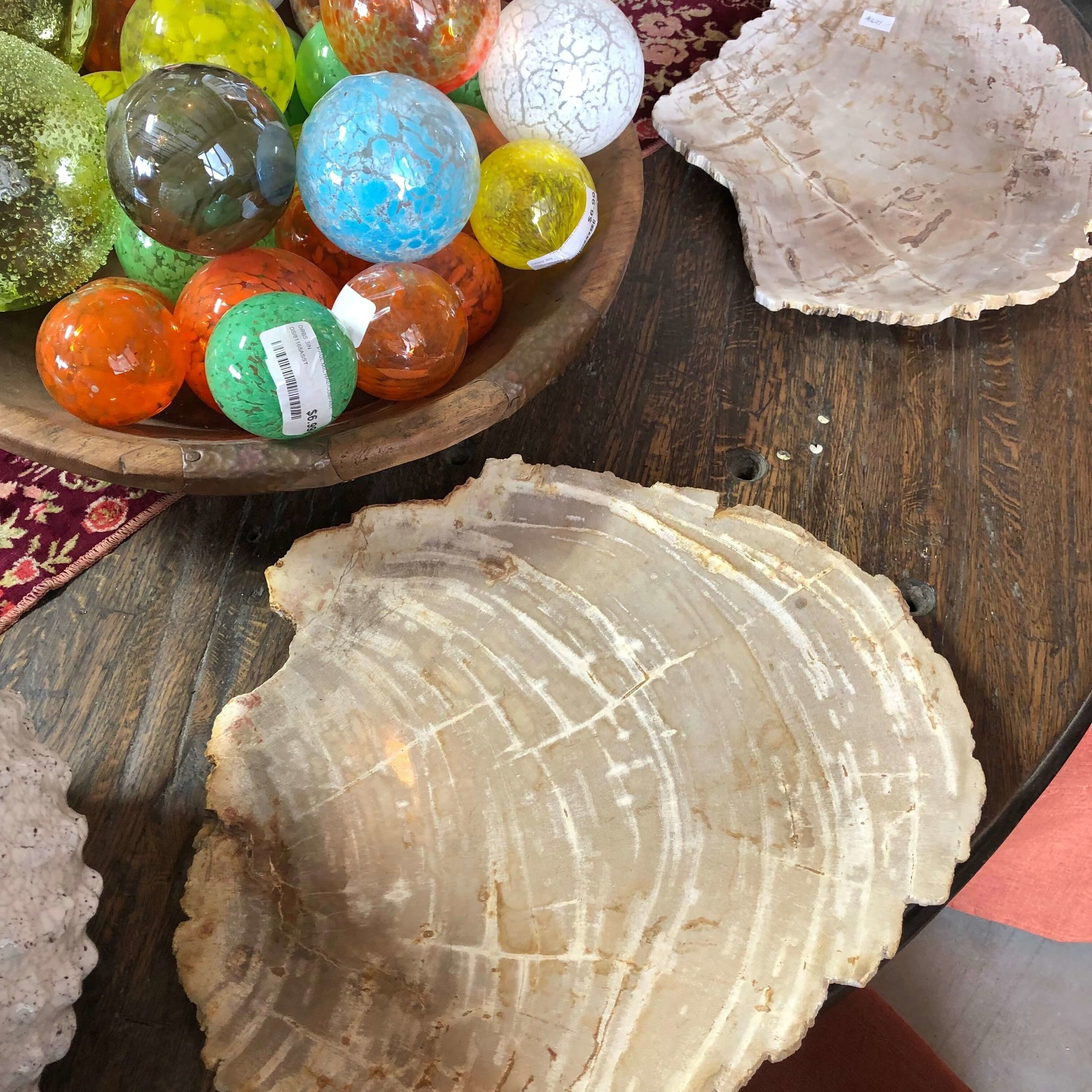 Slices of petrified wood for unique charger plates for your tabletop | Paul Michael, Market Hill, Round Top Antiques Fair
