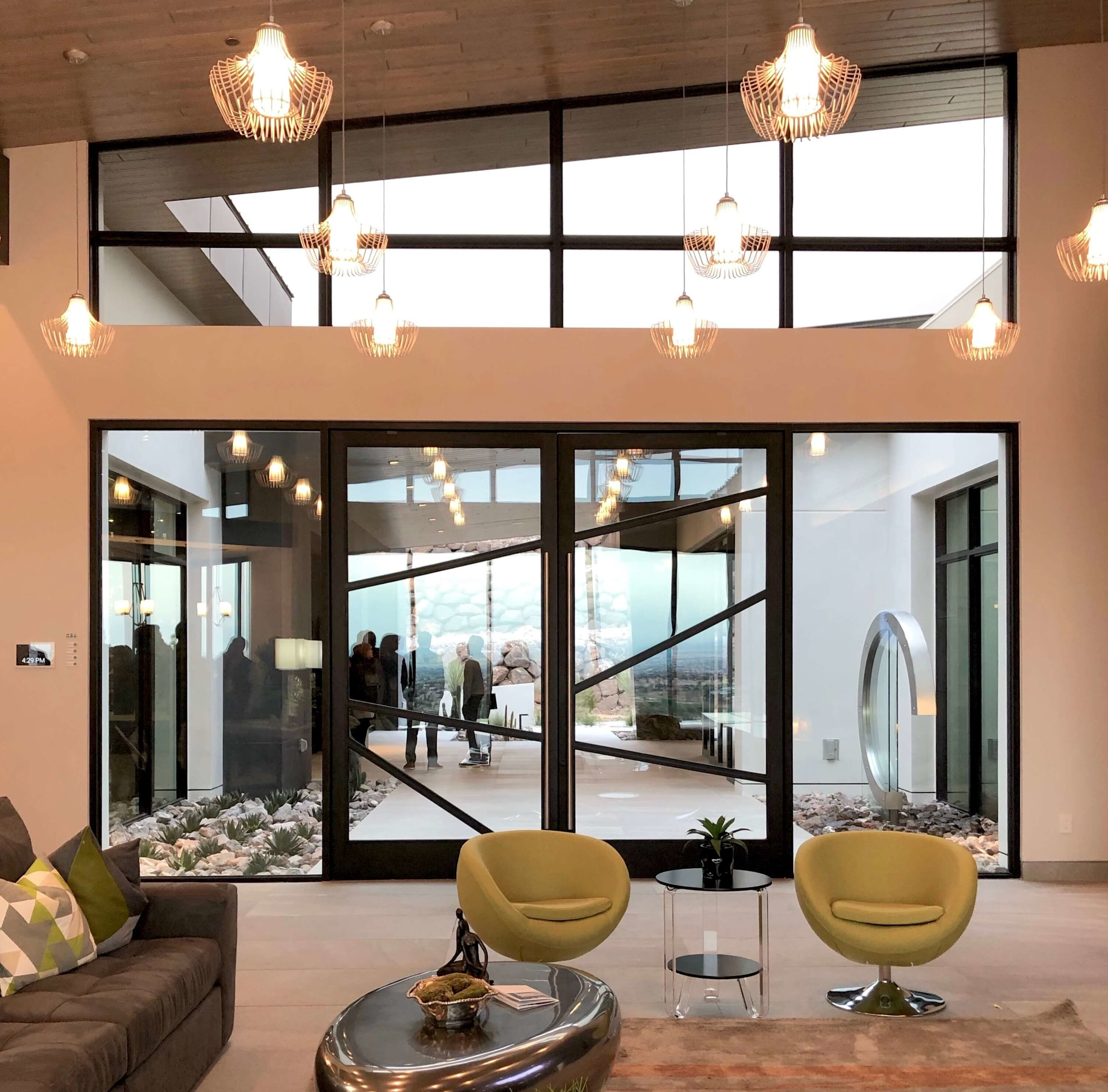 Steel and glass front doors from inside the living room, The New American Home Tour 2019 | Designed and built by Sun West Custom Homes  #contemporaryhome #steeldoors
