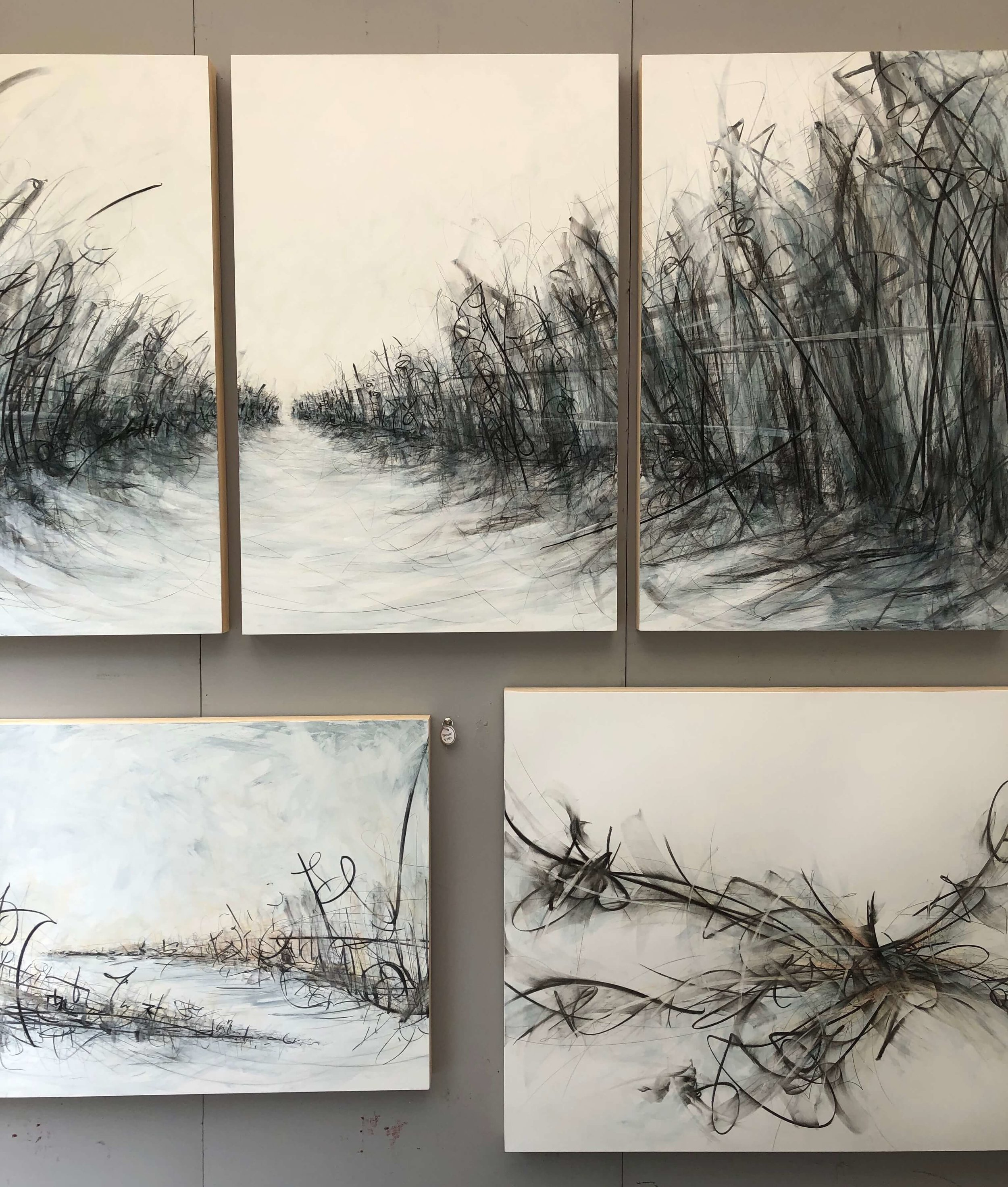Pencil drawings on wood of artist, Brianna Martray, seen at The Woodlands Waterway Art Festival