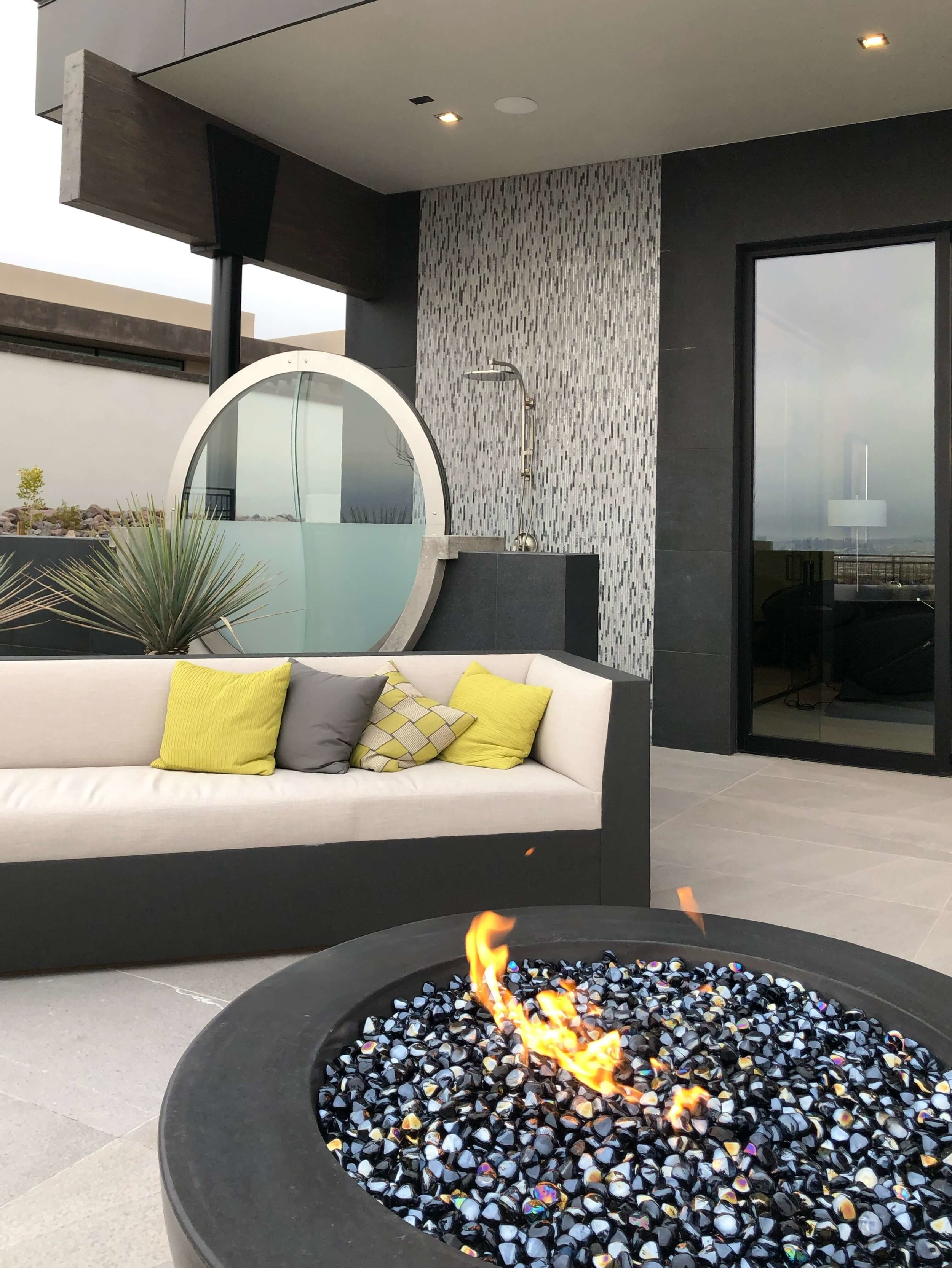 Firepit, lounge area and outdoor shower, The New American Home Tour 2019 | Designed and built by Sun West Custom Homes  #contemporaryhome #firepit