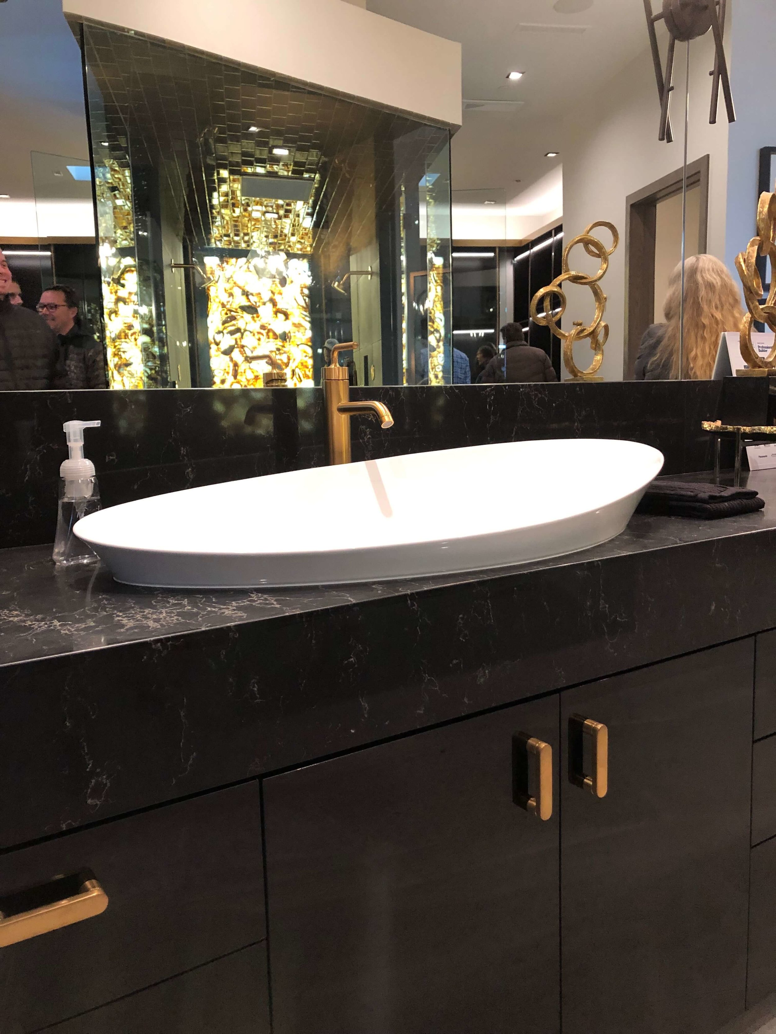 Large curved vessel sink in the master bath, The New American Home Tour 2019 | Designed and built by Sun West Custom Homes  #contemporaryhome #bathroom