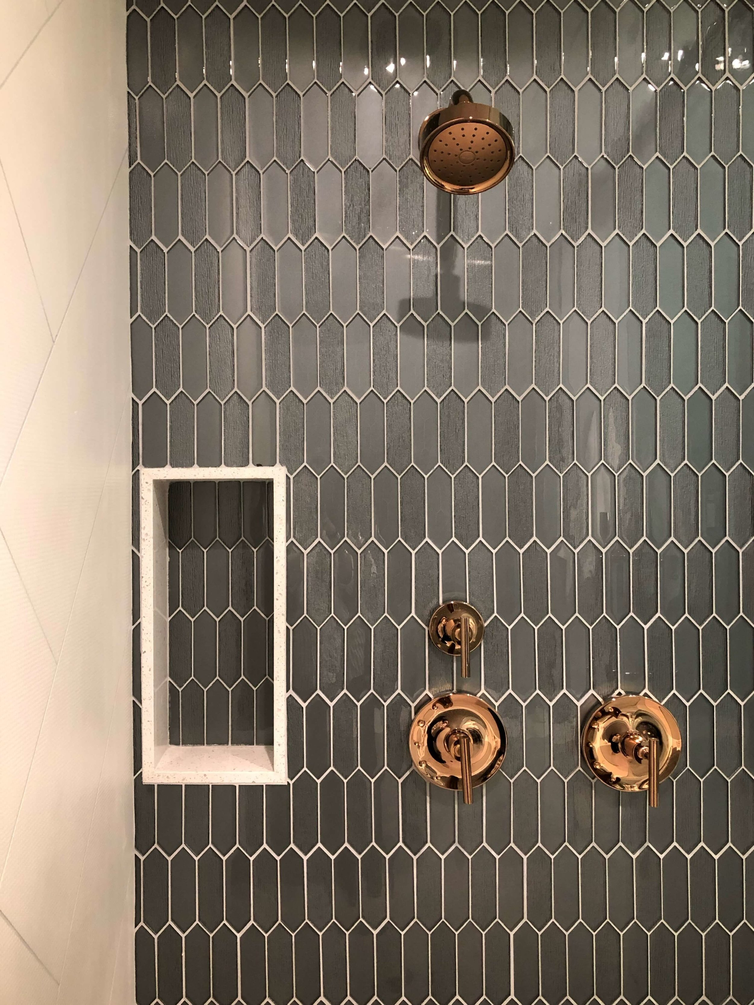 Picket shaped tiles and shampoo niche, The New American Home Tour 2019 | Designed and built by Sun West Custom Homes  #contemporaryhome #bathroom #tile