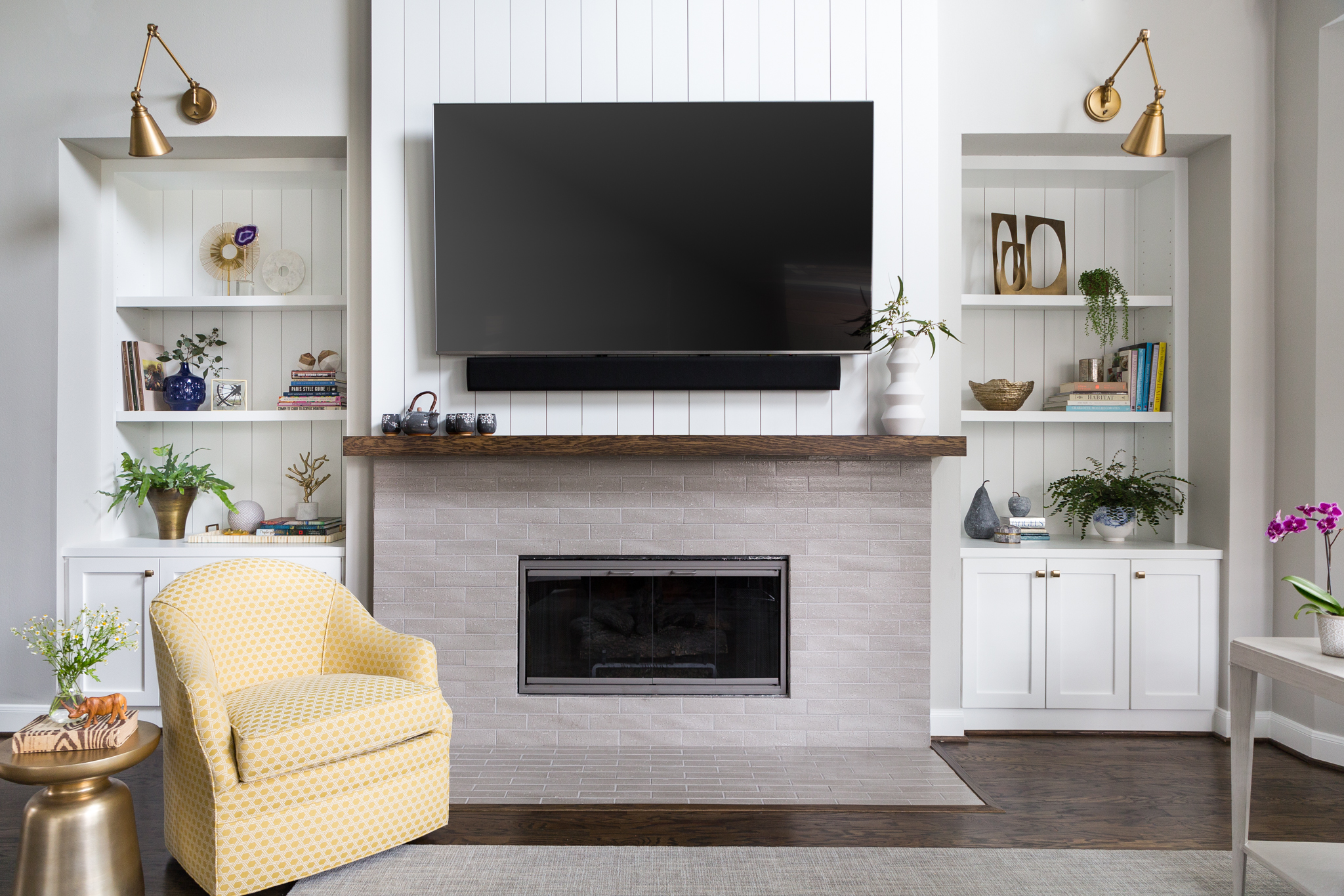 White painted vertical shiplap on fireplace wall and in backs of cabinetry - SW Extra White | Designer: Carla Aston, Photographer: Colleen Scott #whitepaint #whitepaintcolors