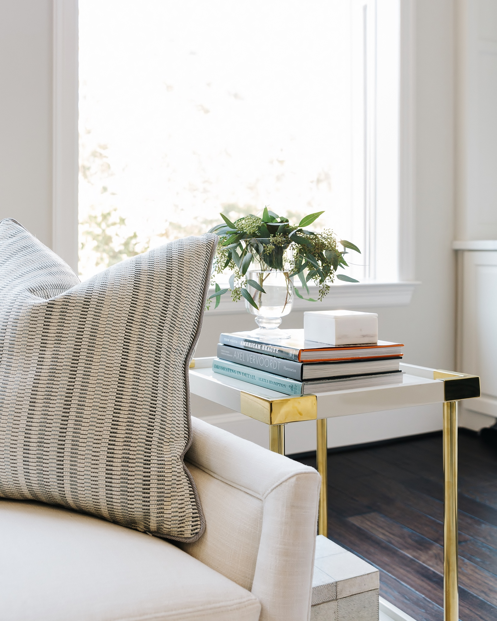 Side table in living room with books for styling | Carla Aston, Designer | Colleen Scott, Photographer #coffeetablebooks #bookshelfstyling #coffeetablestyling
