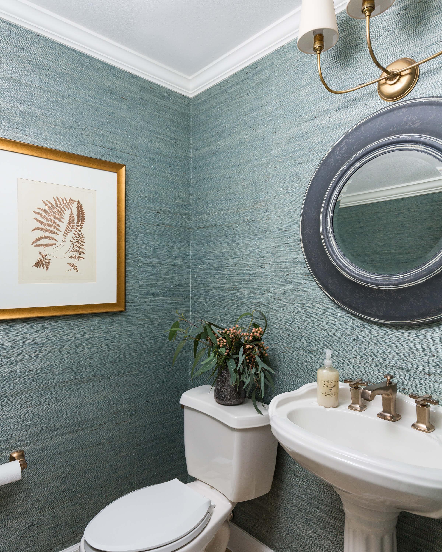 Powder room with turquoise grasscloth and round zinc mirror | Carla Aston, Designer | Colleen Scott, Photographer #powderroom #powderbath #grasscloth