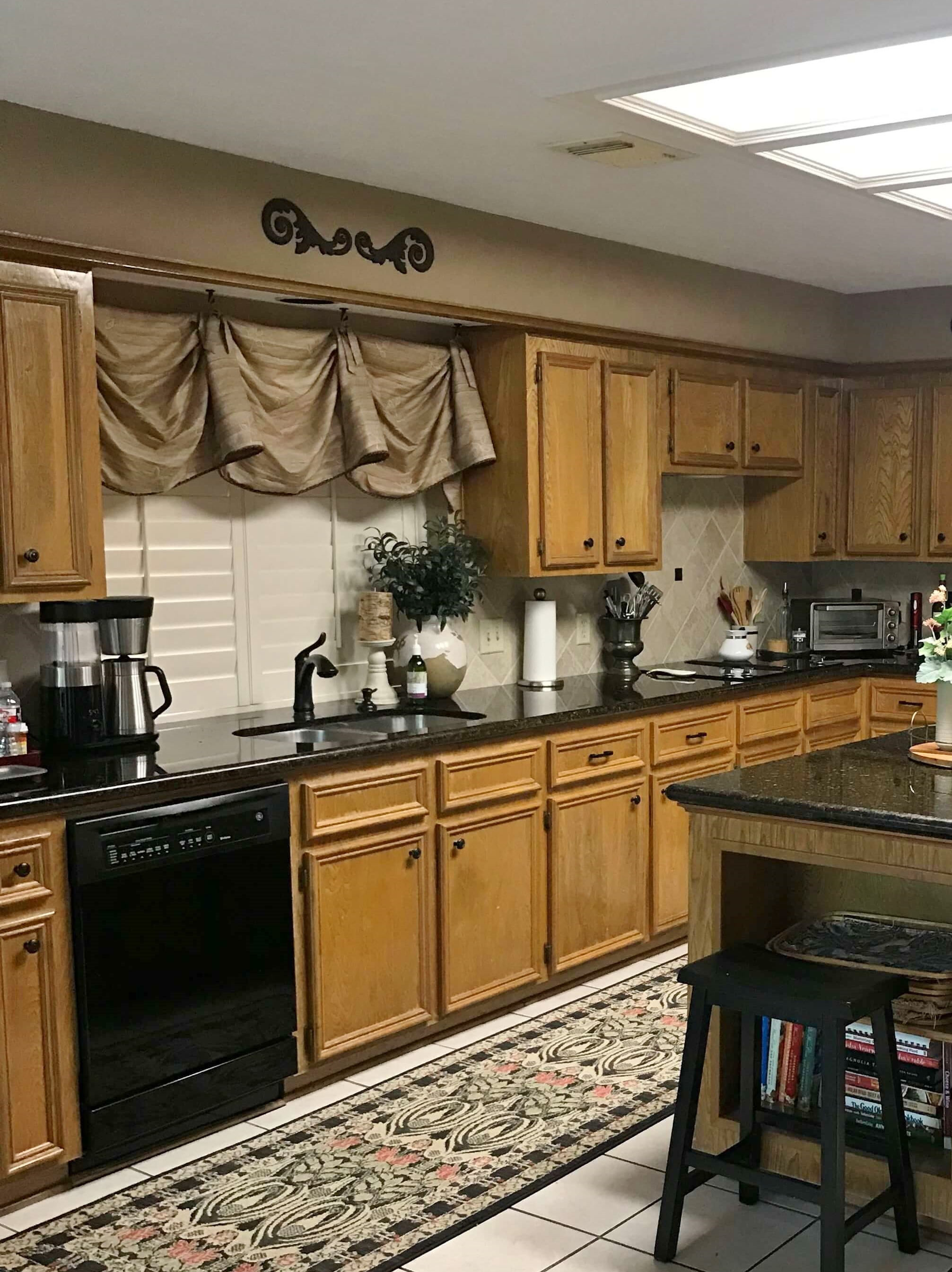 These valances cover half the window area. Since there are shutters here, I don't think any valance is needed. They can take the backsplash tile up and around the window. #valances #windowtreatments