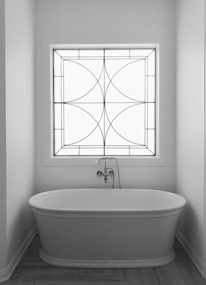 free standing tub with leaded glass window