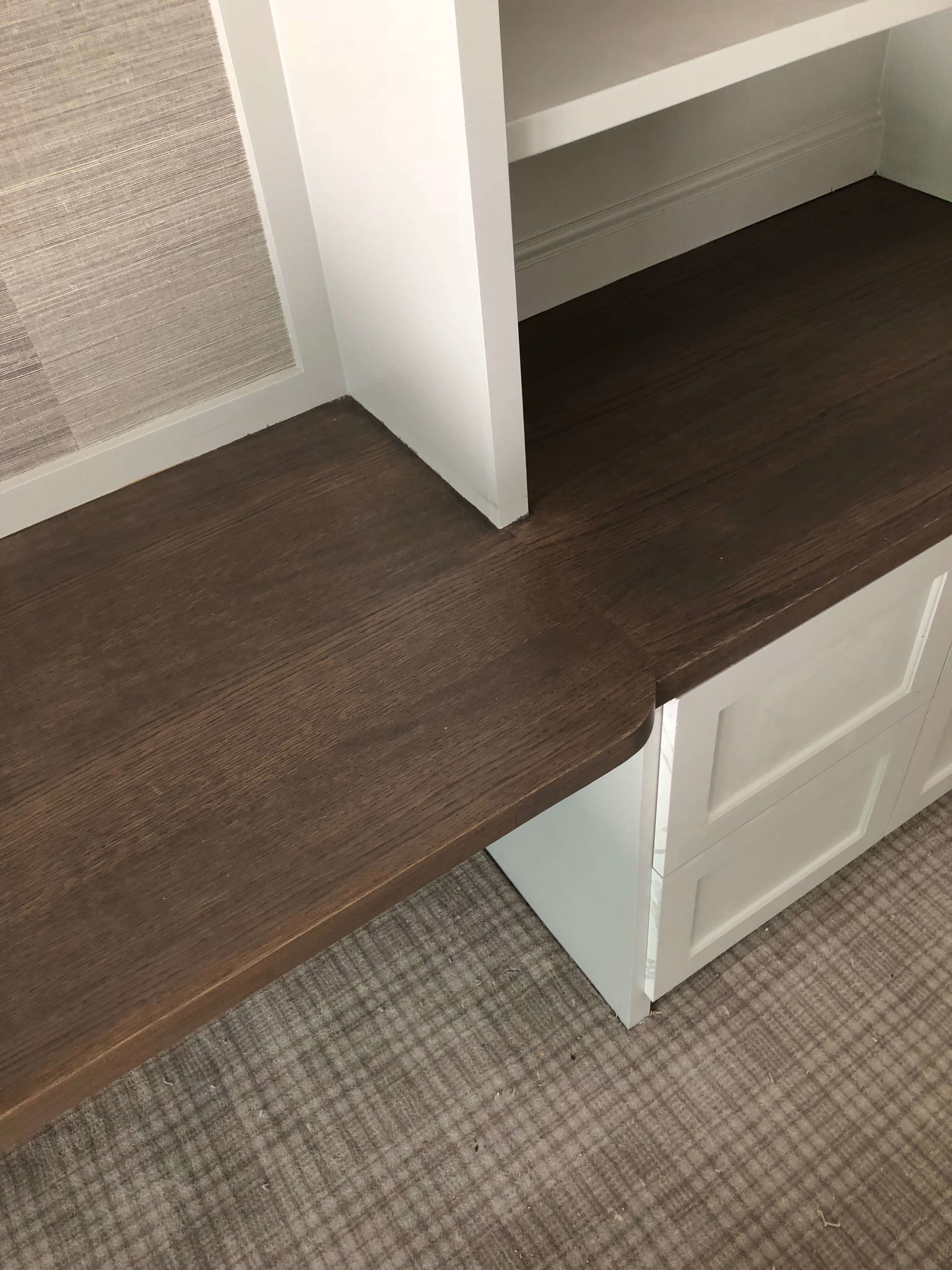 IN PROGRESS - Here's the home office's built-in details. I designed a slight curve for a deeper desk area and grasscloth in the back of the cabinetry over the desk. Love the plaid carpet we chose too. Carla Aston, Designer #homeoffice #desk #cabinetry