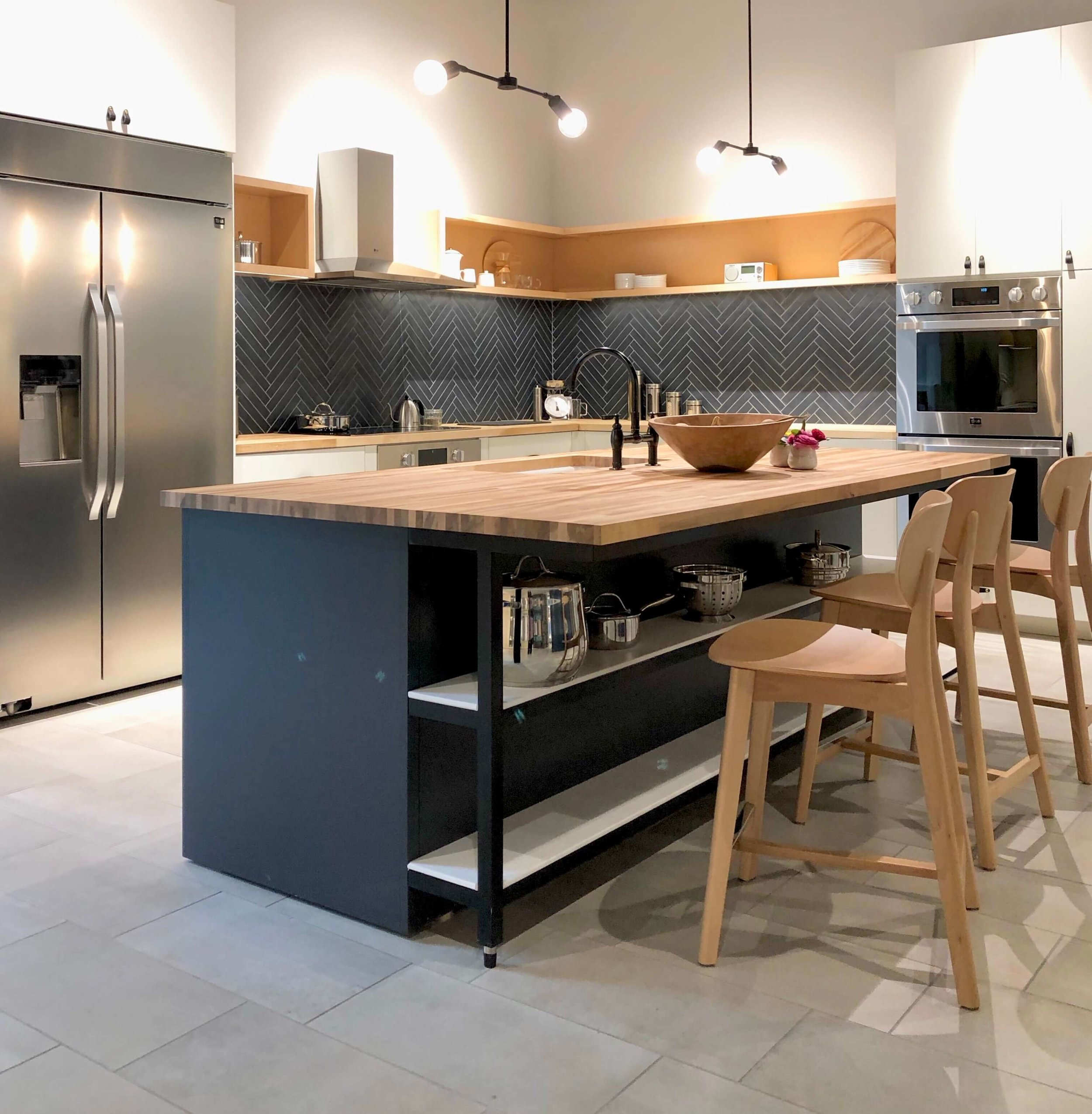 Kitchen with butcher block kitchen island, herringbone tile backsplash, open shelving and LG Appliances | SKS Appliances Experience and Design Center, Napa