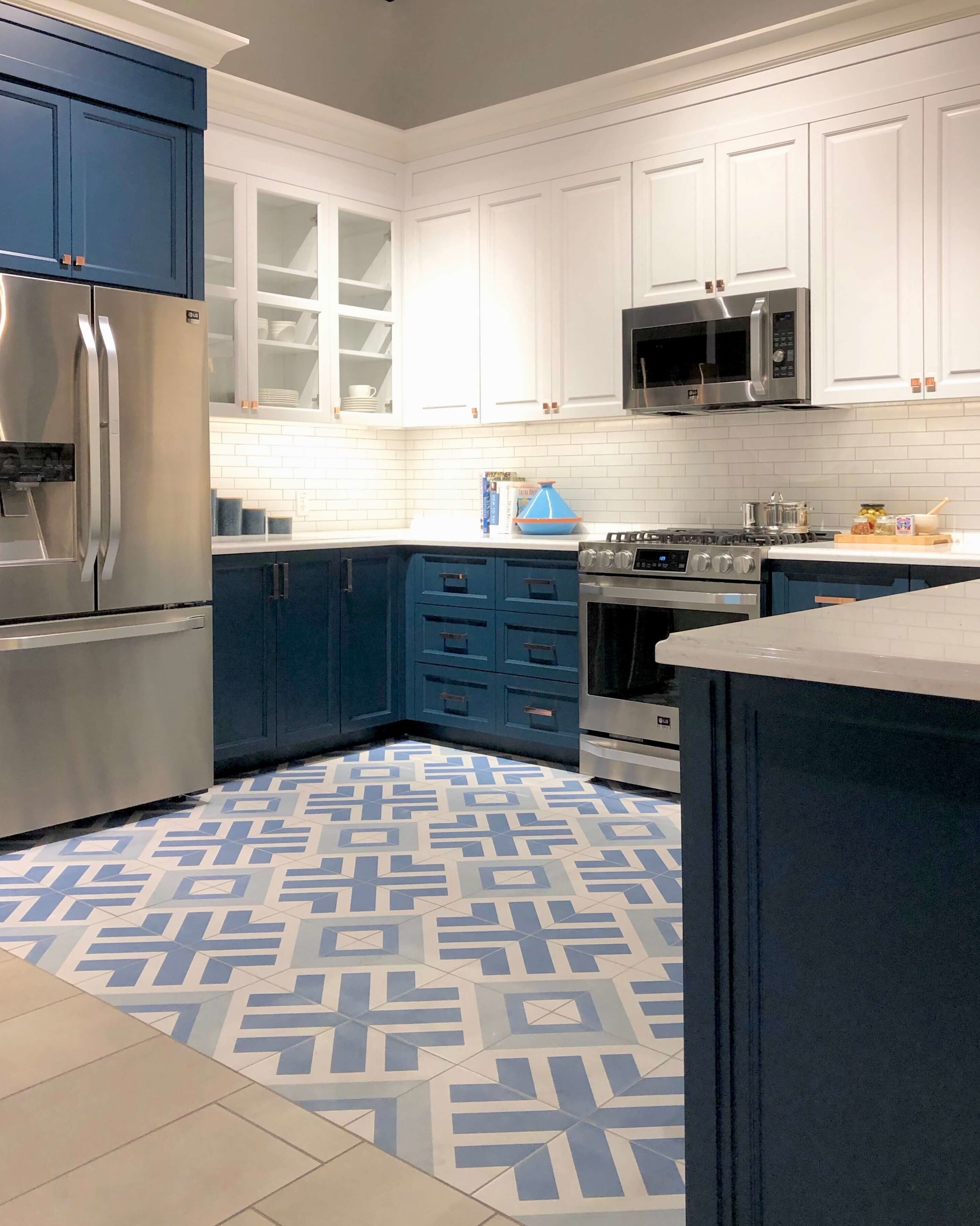 Blue and white two-tone kitchen with patterned concrete tile floor and LG Appliances | SKS Appliances Experience and Design Center, Napa