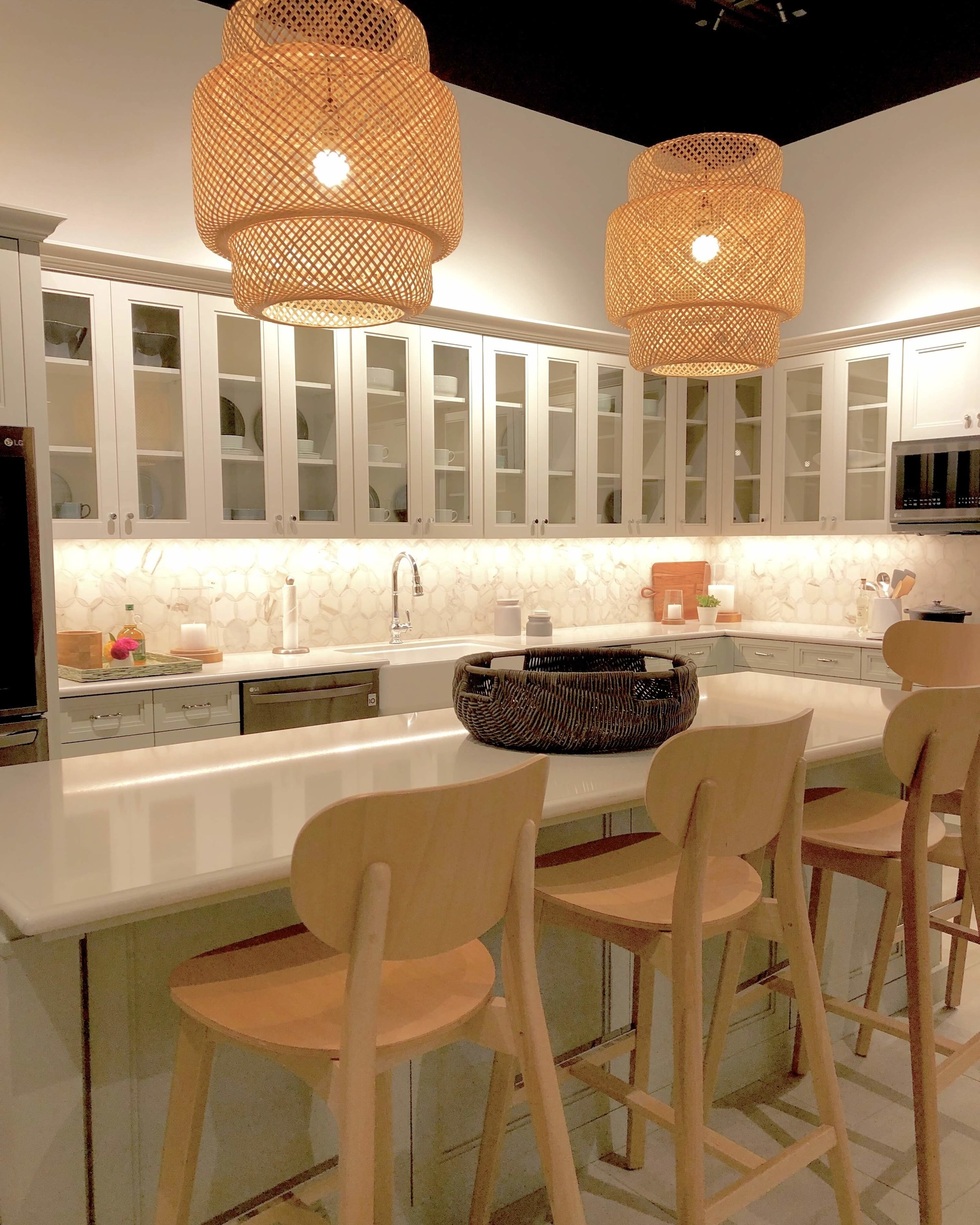 White kitchen with wicker lantern lights and LG Appliances | SKS Appliances Experience and Design Center, Napa
