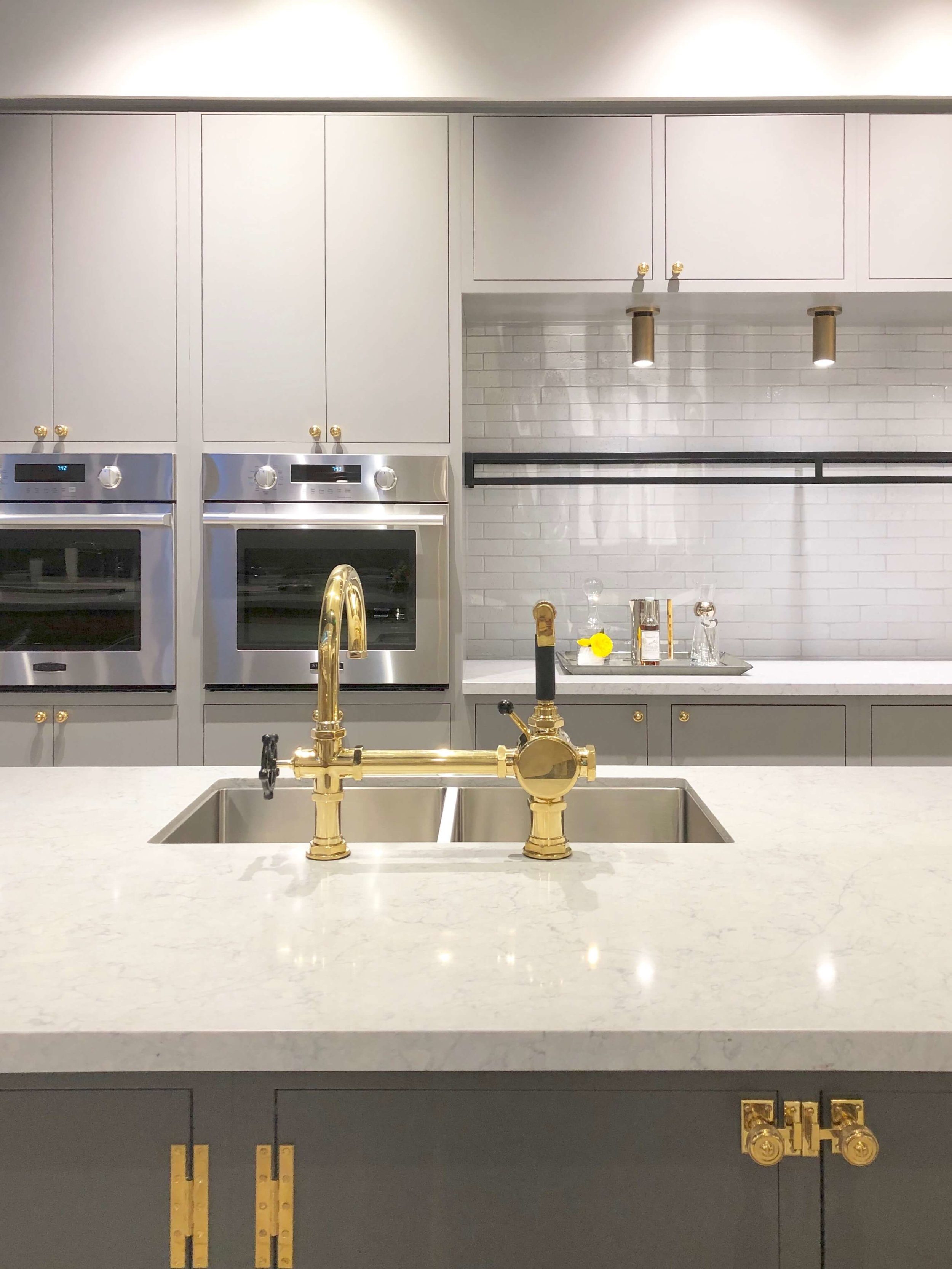 Kitchen with brass hardware, faucets and SKS Appliances | SKS Appliances Experience and Design Center, Napa