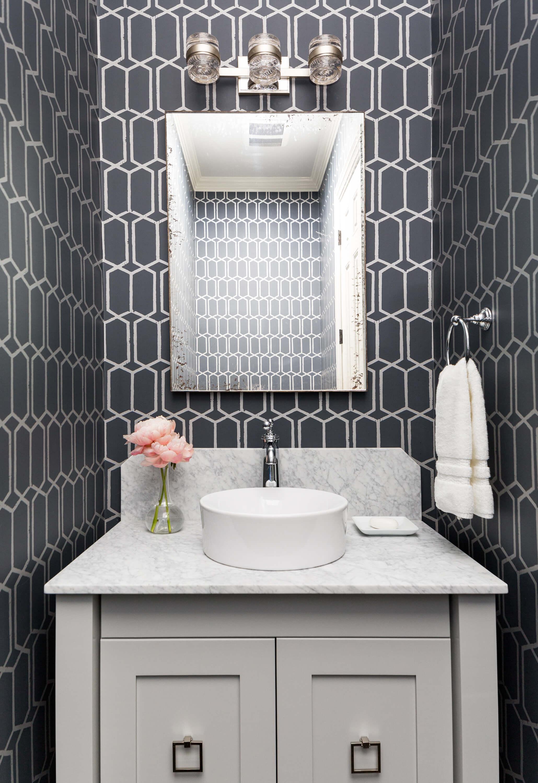 A striking navy blue and gray wallpapered powder room with geometric details and Carrara marble. Carla Aston, Designer | Colleen Scott, Photographer #powderroom #powderbath