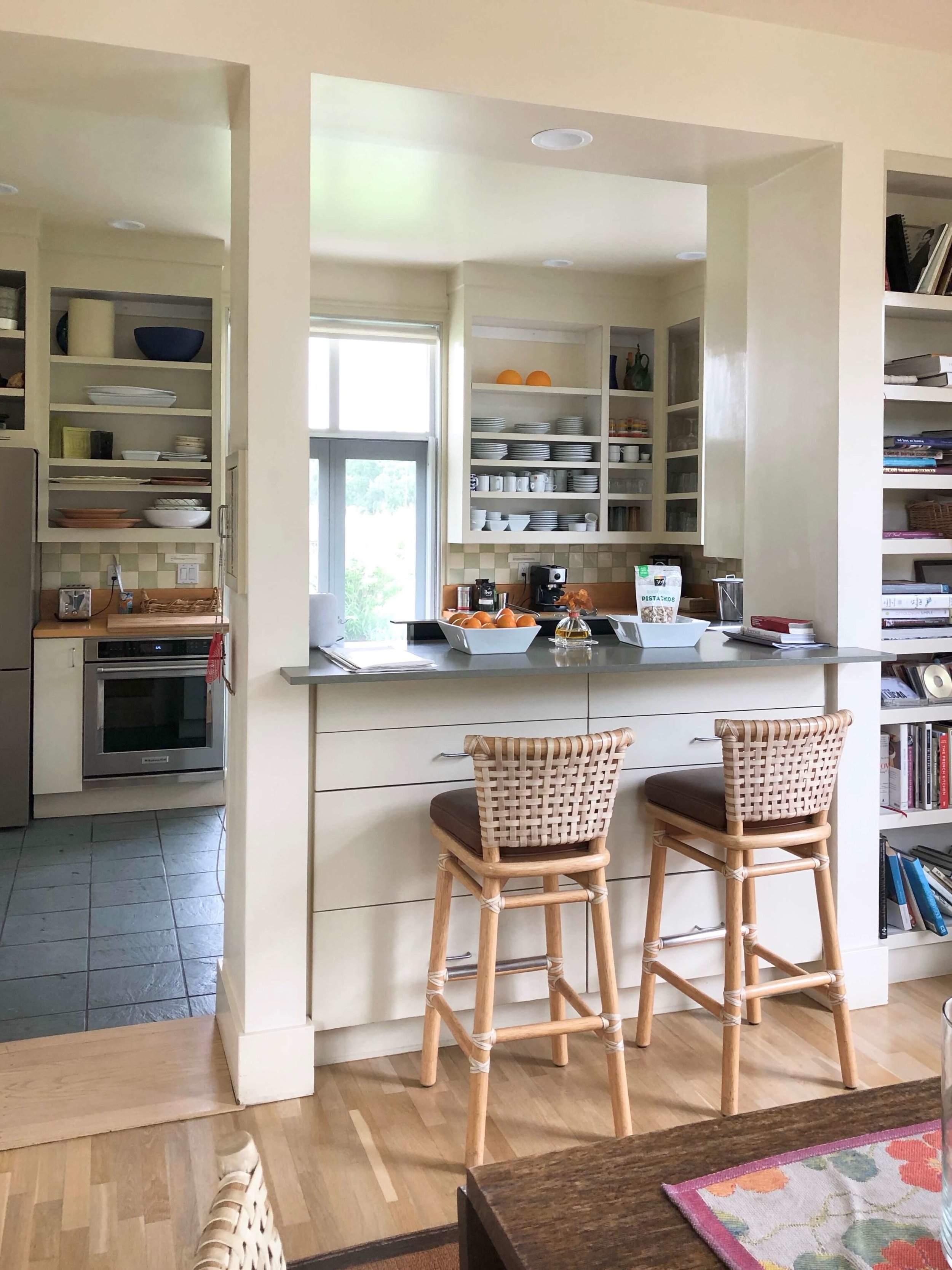 Peering from the dining room to the kitchen over the bar at this Sonoma Valley Airbnb. Great appliances, an espresso maker, and quality cookware make this a fab kitchen for cooking some family style meals. #airbnb #winecountry #farmhousekitchen