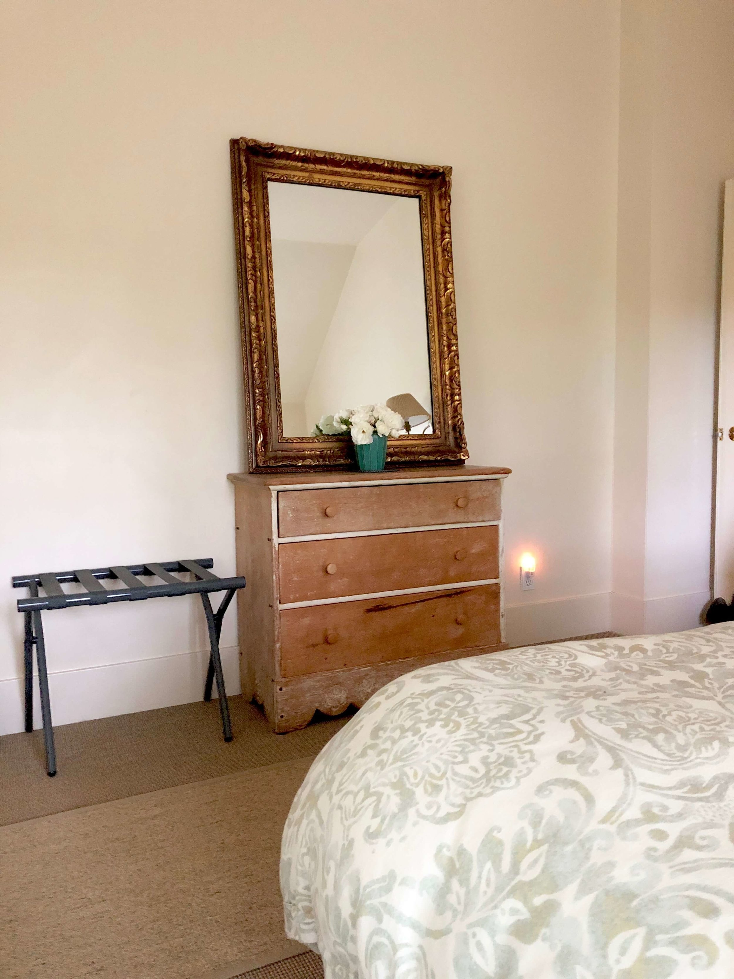 Simple rustic furniture, high quality bed linens, white roses and all needs thoughtfully attended to in the bedrooms of Sonoma Valley Airbnb. #airbnb #winecountry #cottagebedroom