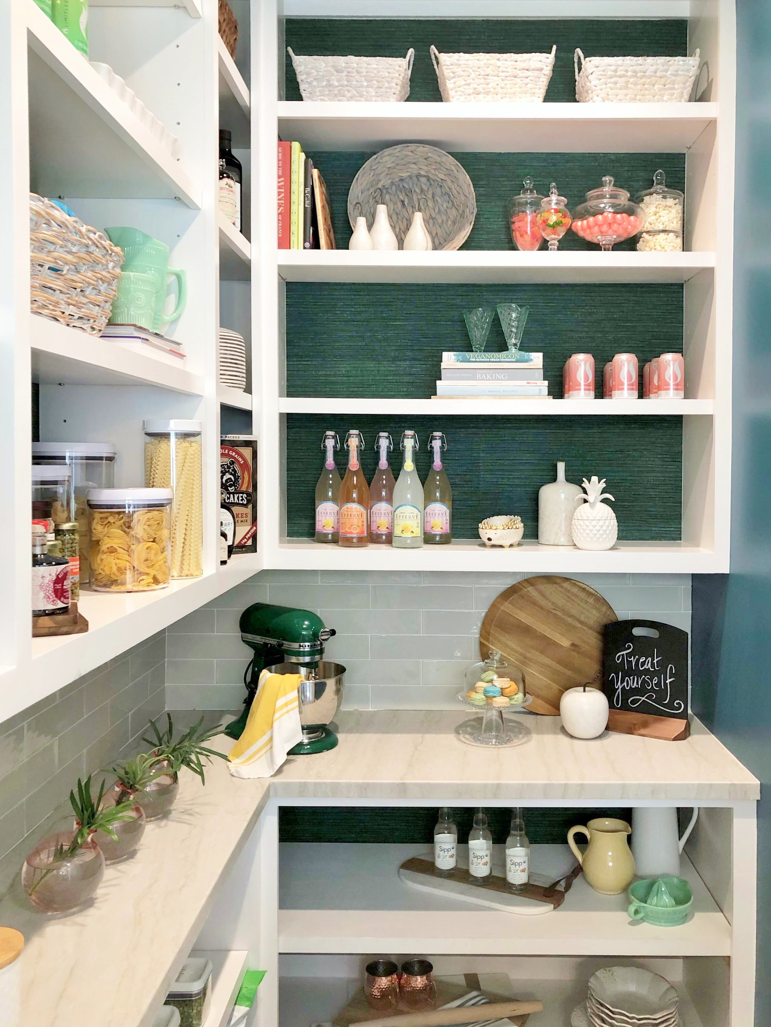 Fabulous pantry with green grasscloth wallcovering and quartzite countertop designed by Chairma Design Group at the ASID Showhouse, Houston. #pantry #kitchen