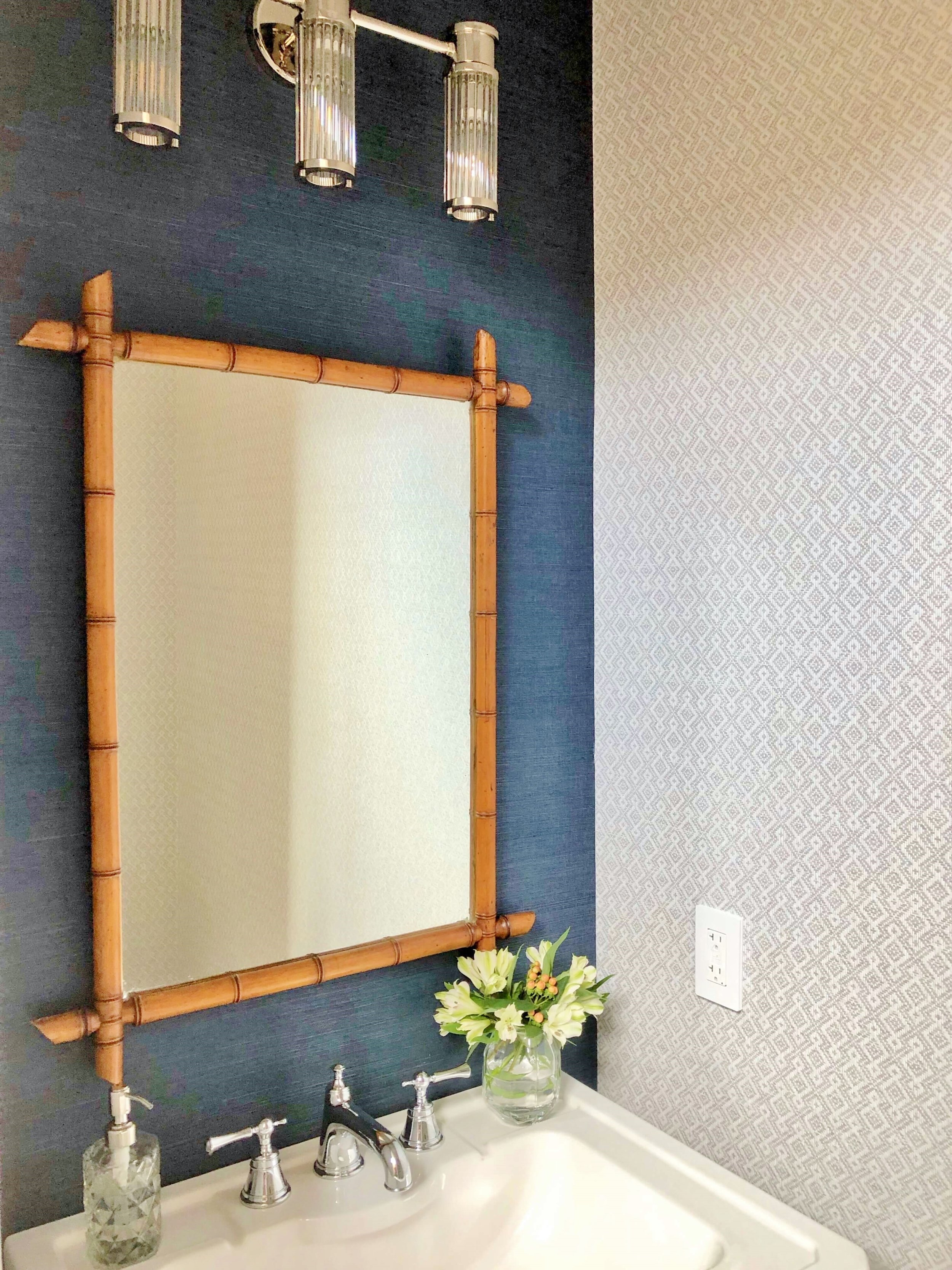 Powder room with bamboo mirror and textural grasscloth wallcoverings, designed by Jennifer Harbison of Cobalt Living at the ASID Showhouse, Houston. #powderroom