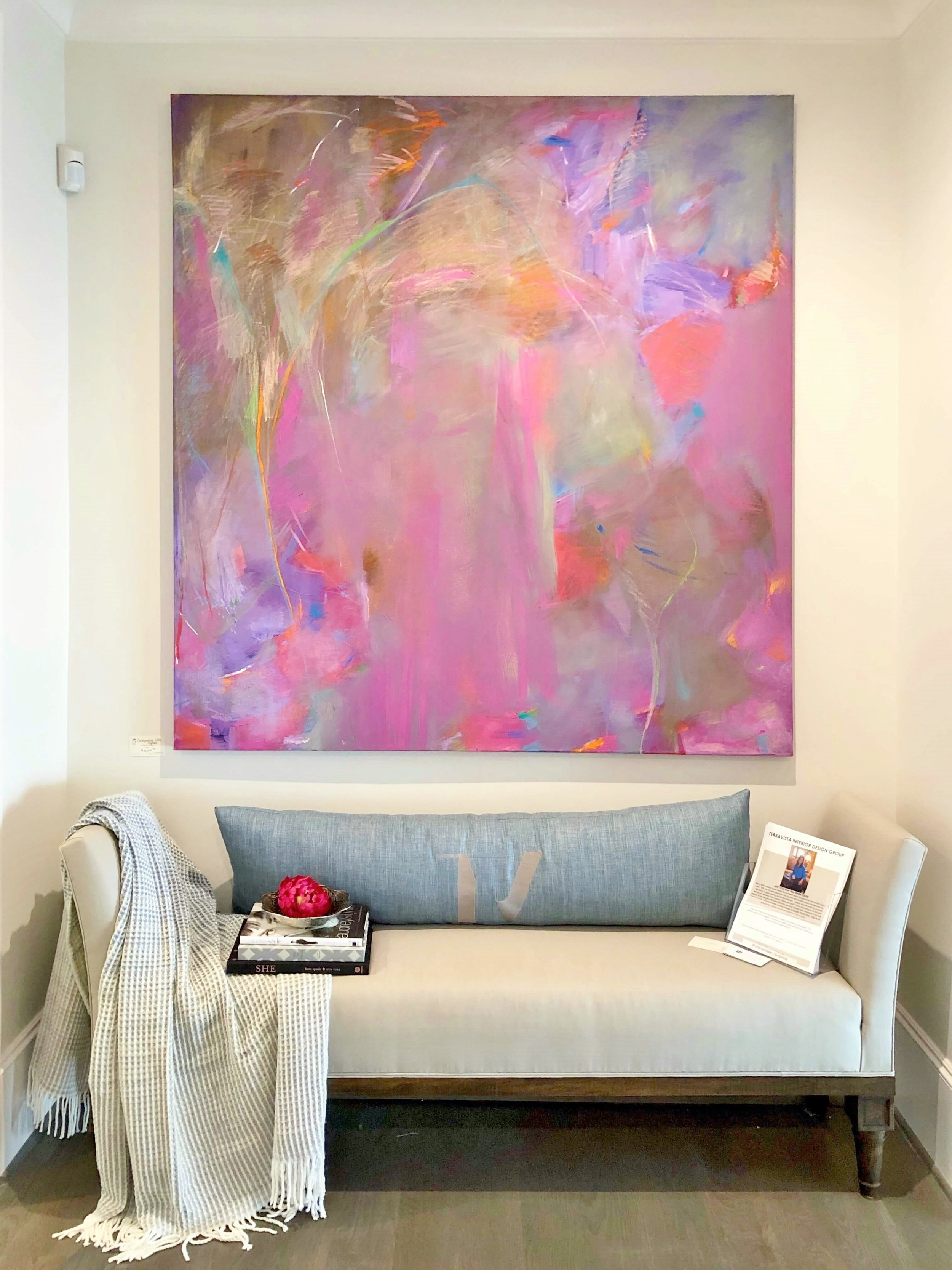 This colorful art made a strong statement in this hallway niche designed by Sherry Millien of TerraVista Design at the ASID Showhouse, River Oaks, Houston. #settee #pinkart