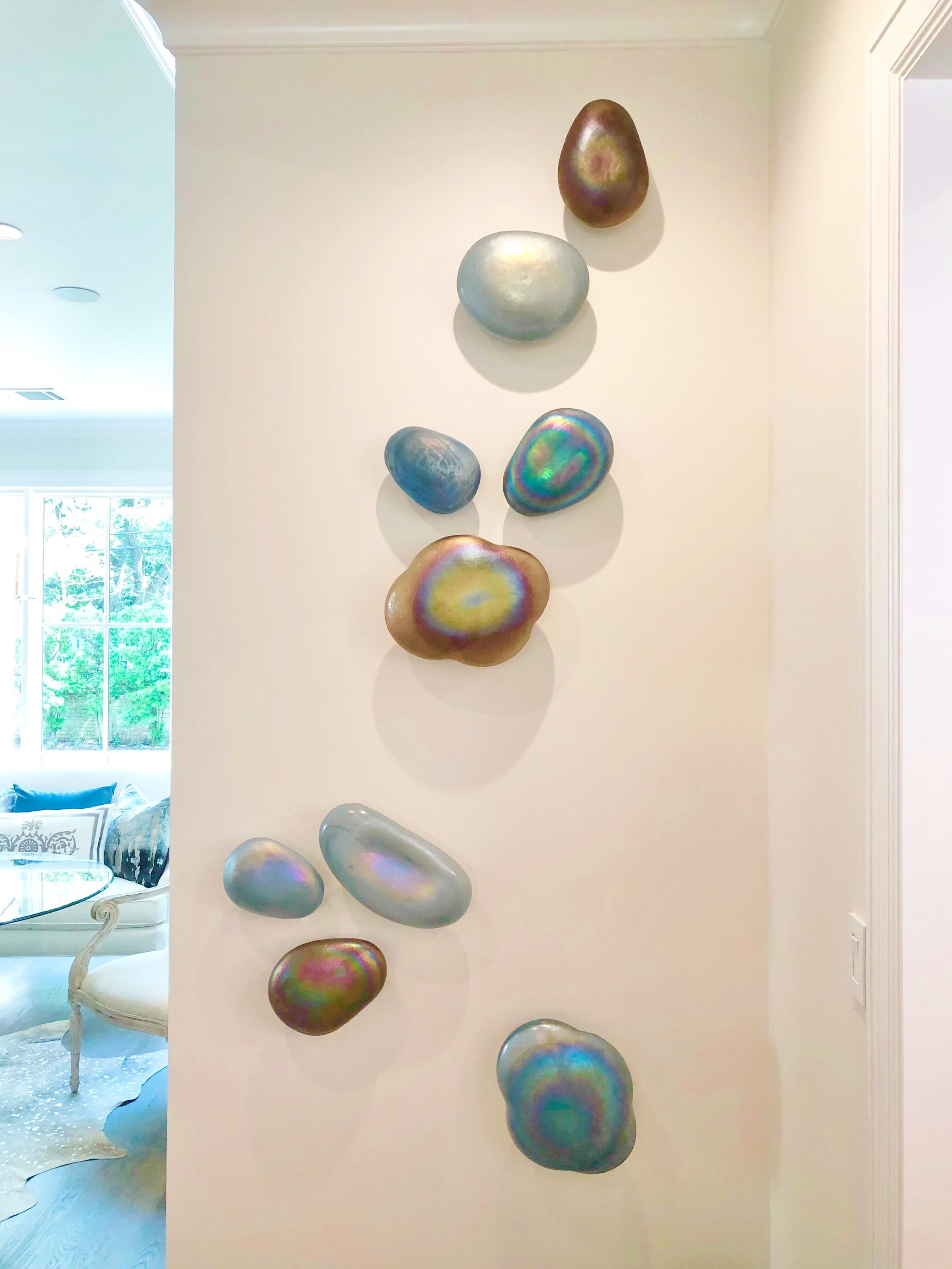 More gorgeous art in the family room designed by The Design Firm. These iridescent sculptural shapes can be artfully arranged in any kind of configuration to bring a fresh look to any space. ASID Showhouse, Houston. #art #walldecor