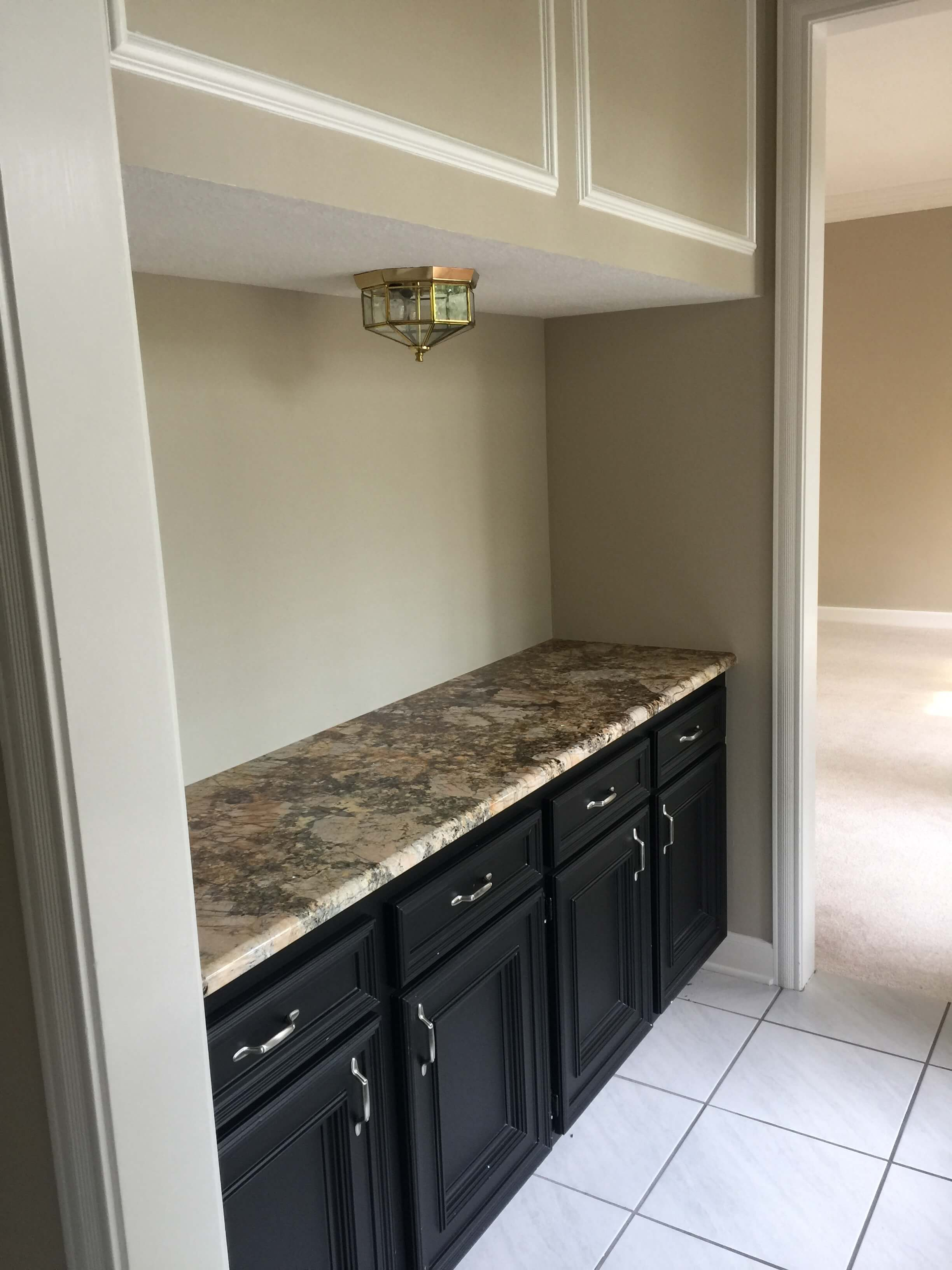 BEFORE - These cabinets under the stairs felt short and squatty because of the landing above. That light fixture was right at about eye level.