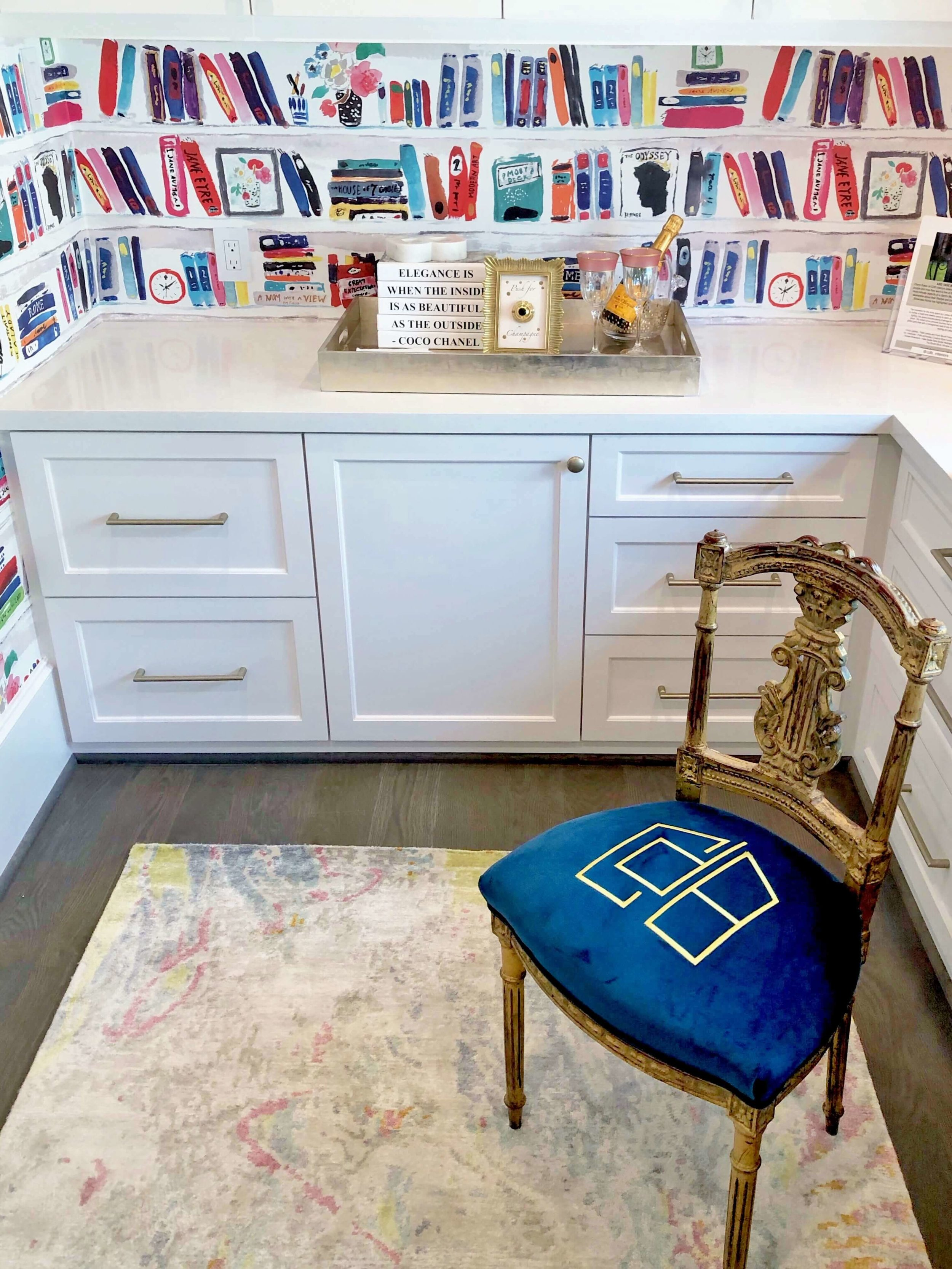 A small monogrammed antique chair adds the perfect touch to the brightly colored wallpapered home office, designed by Cheryl Baker of CDB Interiors. | ASID River Oaks Showhouse #homeoffice #katespade #wallpaper