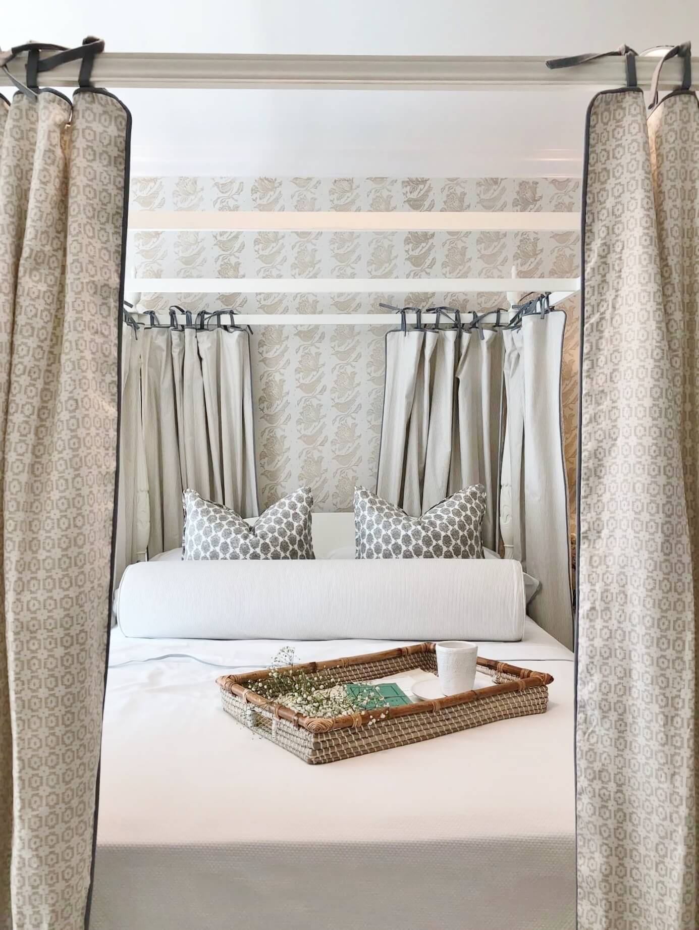 This bedroom was a vision of neutral, tone on tone pattern creating a private space with a lovely canopy bed. Designer, Sherrell Neal, Sherrell Design Studio | ASID River Oaks Showhouse #canopybed #neutralbedroom #whitebedding