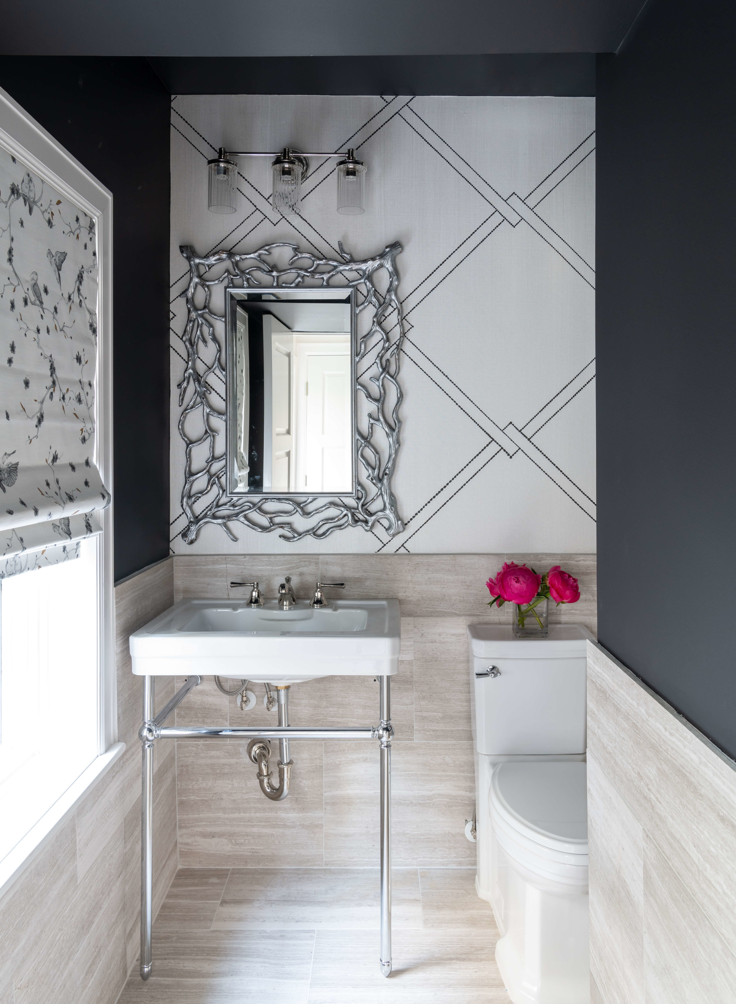 This pretty downstairs powder room with bold black walls and a graphic wall pattern was designed by Lauren Ashley of LA Designer Affair. | ASID River Oaks Showhouse, Photographer - Michael Hunter #powderroom #powderbath