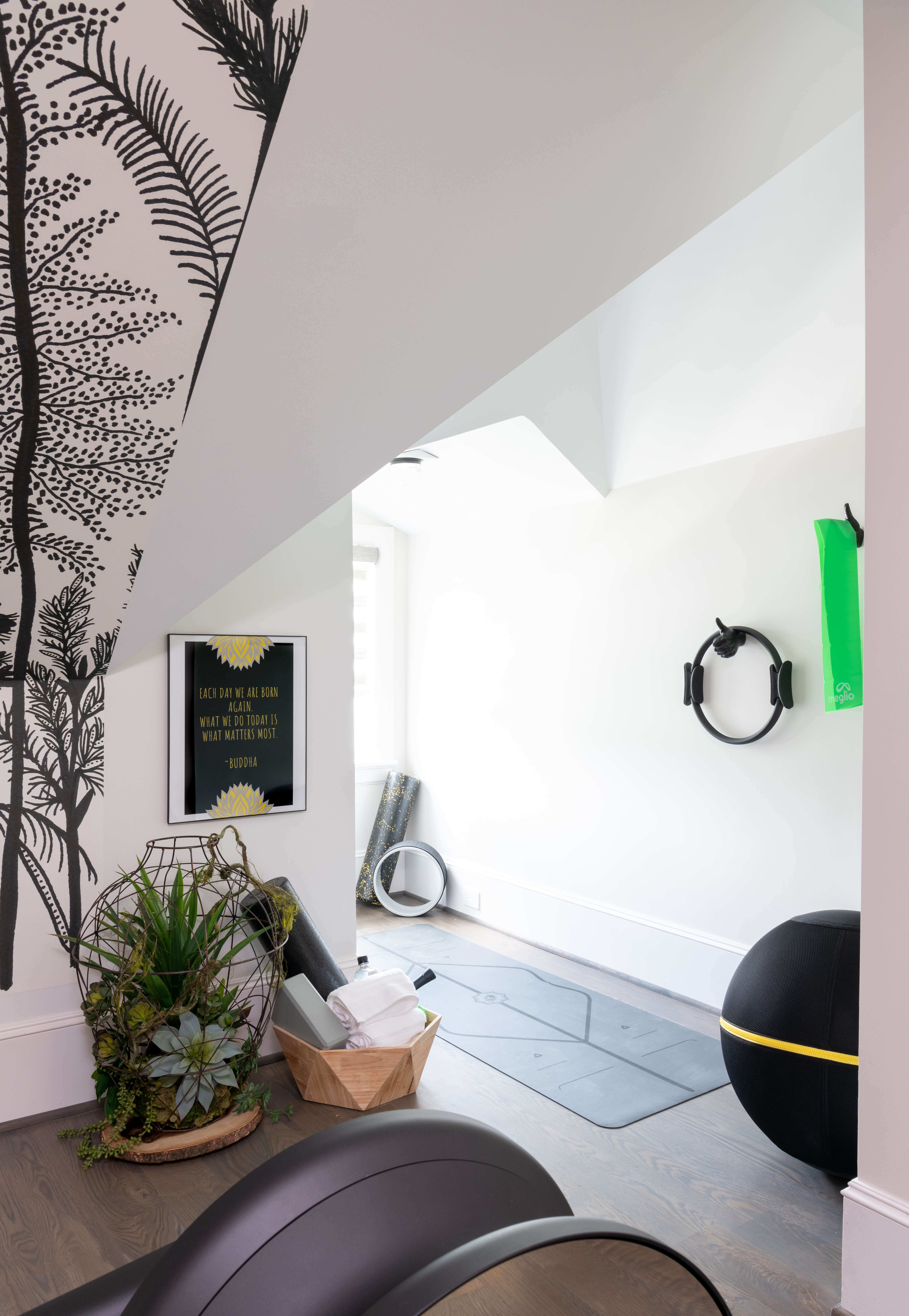 The exercise room on the 3rd floor of this home takes advantage of the open space with an energizing mural and exercise equipment. Designed by Saima Seyar, Elima Designs | ASID River Oaks Showhouse, Photographer - Michael Hunter #exerciseroom #workoutroom