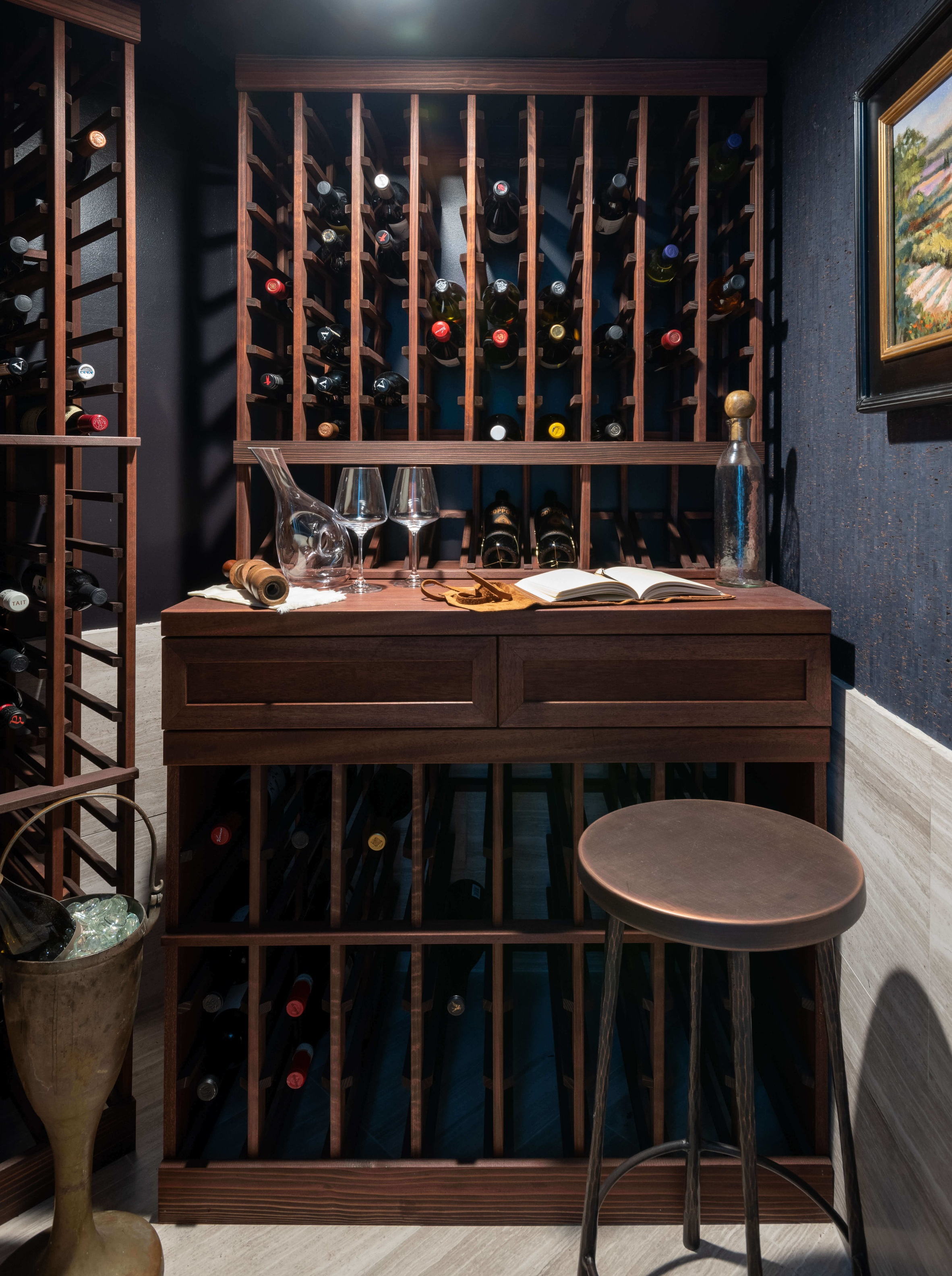 Wine room with navy grasscloth by Jennifer Harbison of Cobalt Living at the ASID Showhouse,  Houston. Michael Hunter, Photographer #wineroom