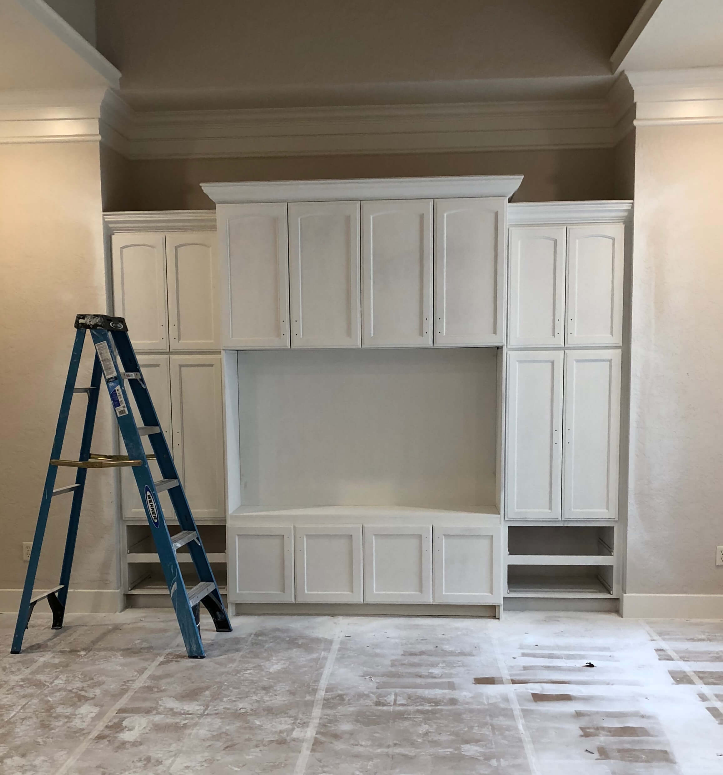 IN PROGRESS - Primed and ready for finishing, the lower cabinet and false back were added in to the existing deep tv cabinetry on this job. #tvcabinet