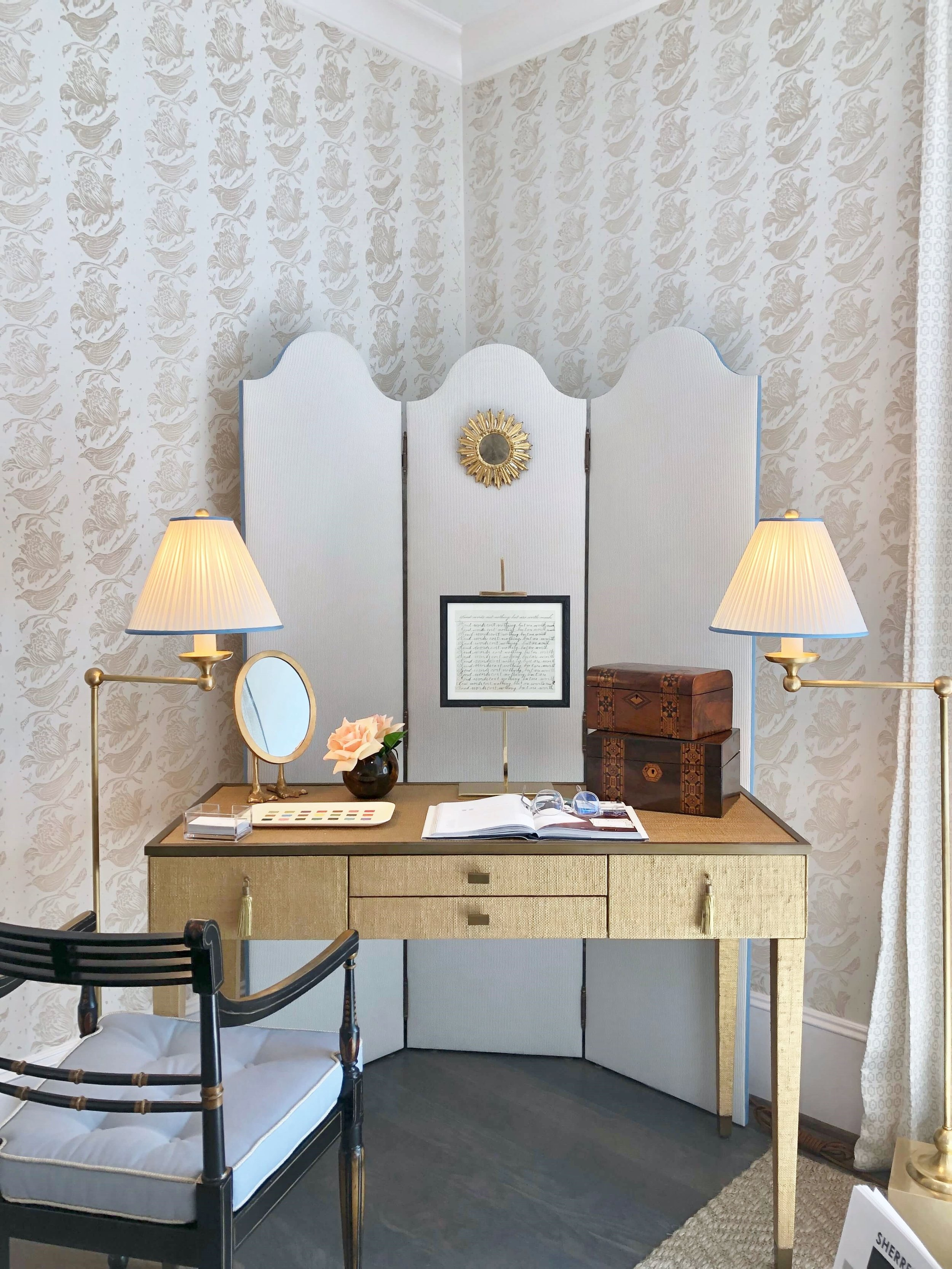 Small desk on an angle in the neutral bedroom with an upholstered screen and pretty wall pattern. Designer, Sherrell Neal, Sherrell Design Studio | ASID River Oaks Showhouse #neutraldecor #desk #bedroom