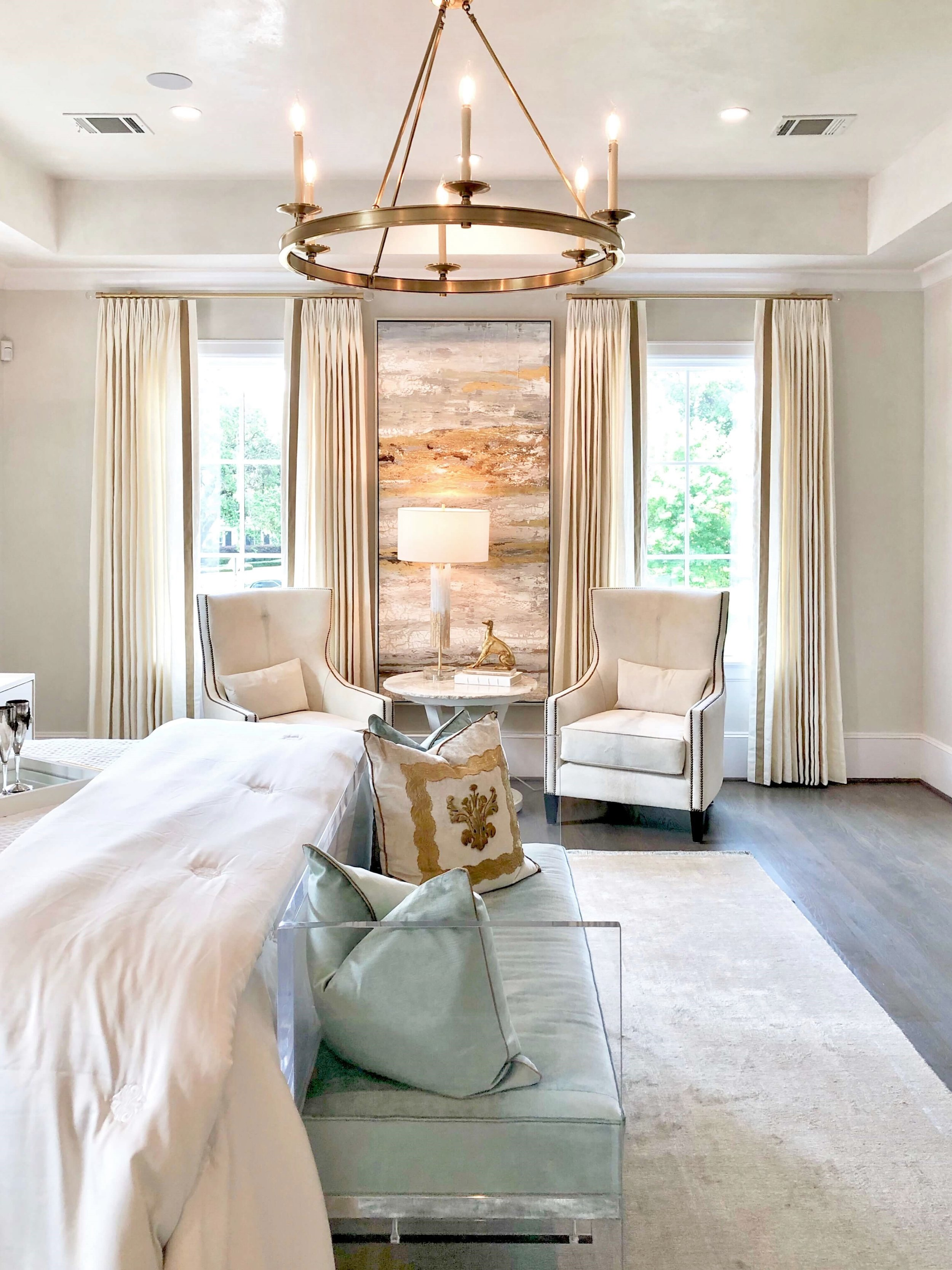 The luxurious master bedroom was designed in soft turquoise and white with plush white bedding by Teena Caldwell of Twenty-Two Fifty Interiors. | ASID River Oaks Showhouse #masterbedroom #whitebedding #bedroomdesign