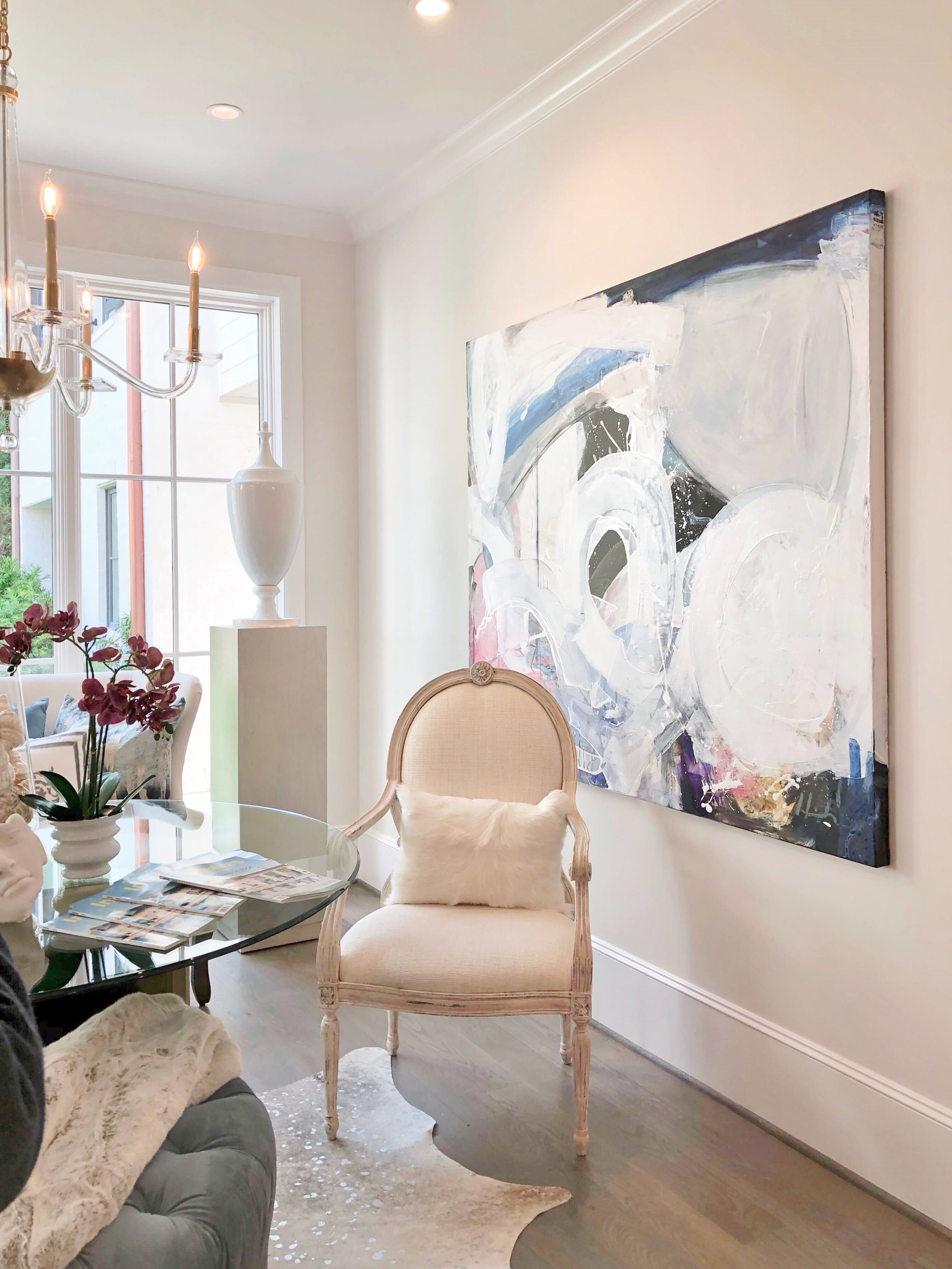 Bold art in the breakfast area of the ASID Showhouse, by The Design Firm. #art #walldecor #whitedecor
