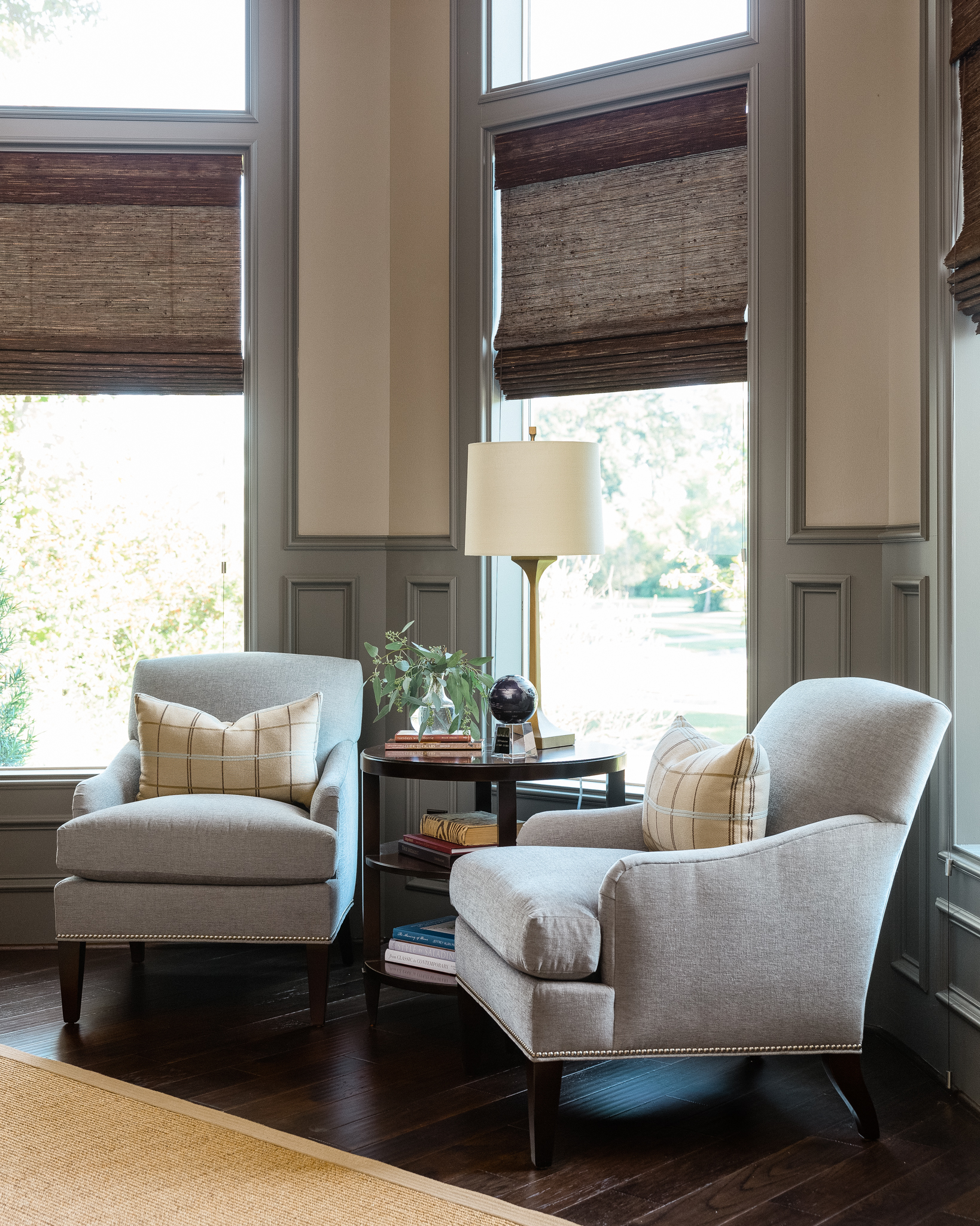 Woven wood shades fit perfectly in this home office corner, designed by Carla Aston | Colleen Scott, Photographer #windowtreatment #wovenwoodshade
