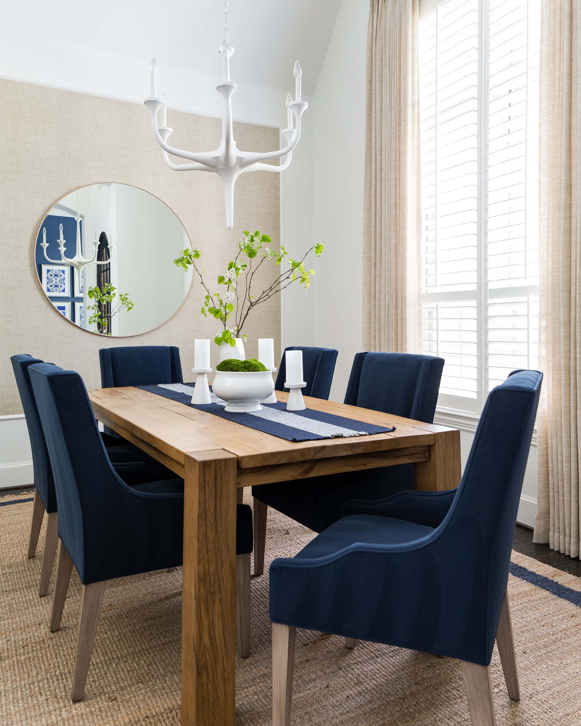 This dining room with sheer, textural draperies create warmth and add height to this dining room. Carla Aston, Designer | Colleen Scott, Photographer #windowtreatment #drapery #sheerdrapery #diningroom