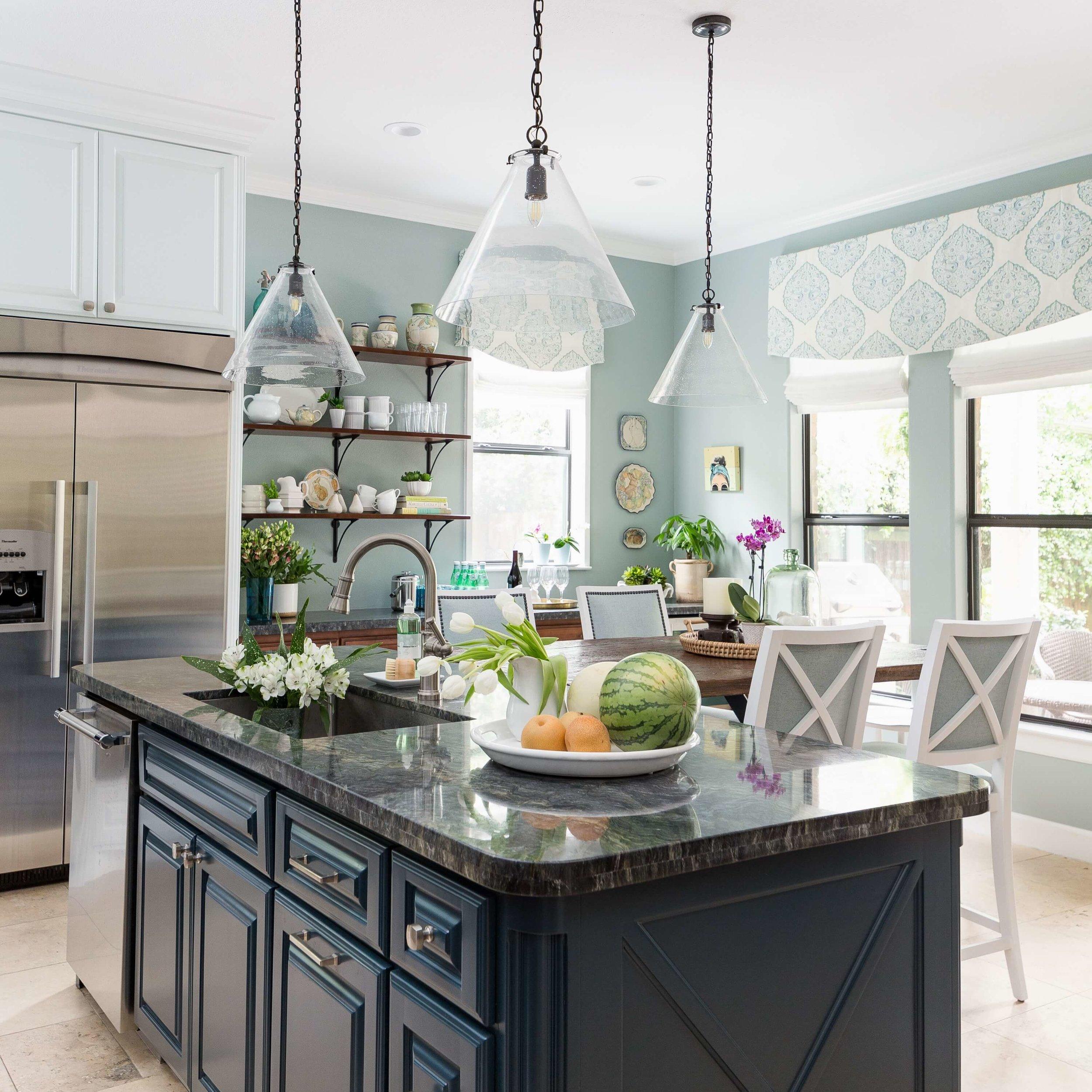 Window valances and Roman shades layer in softness in this coastal style kitchen. Carla Aston, Designer | Colleen Scott, Photographer #windowvalances #Romanshades #windowtreatments