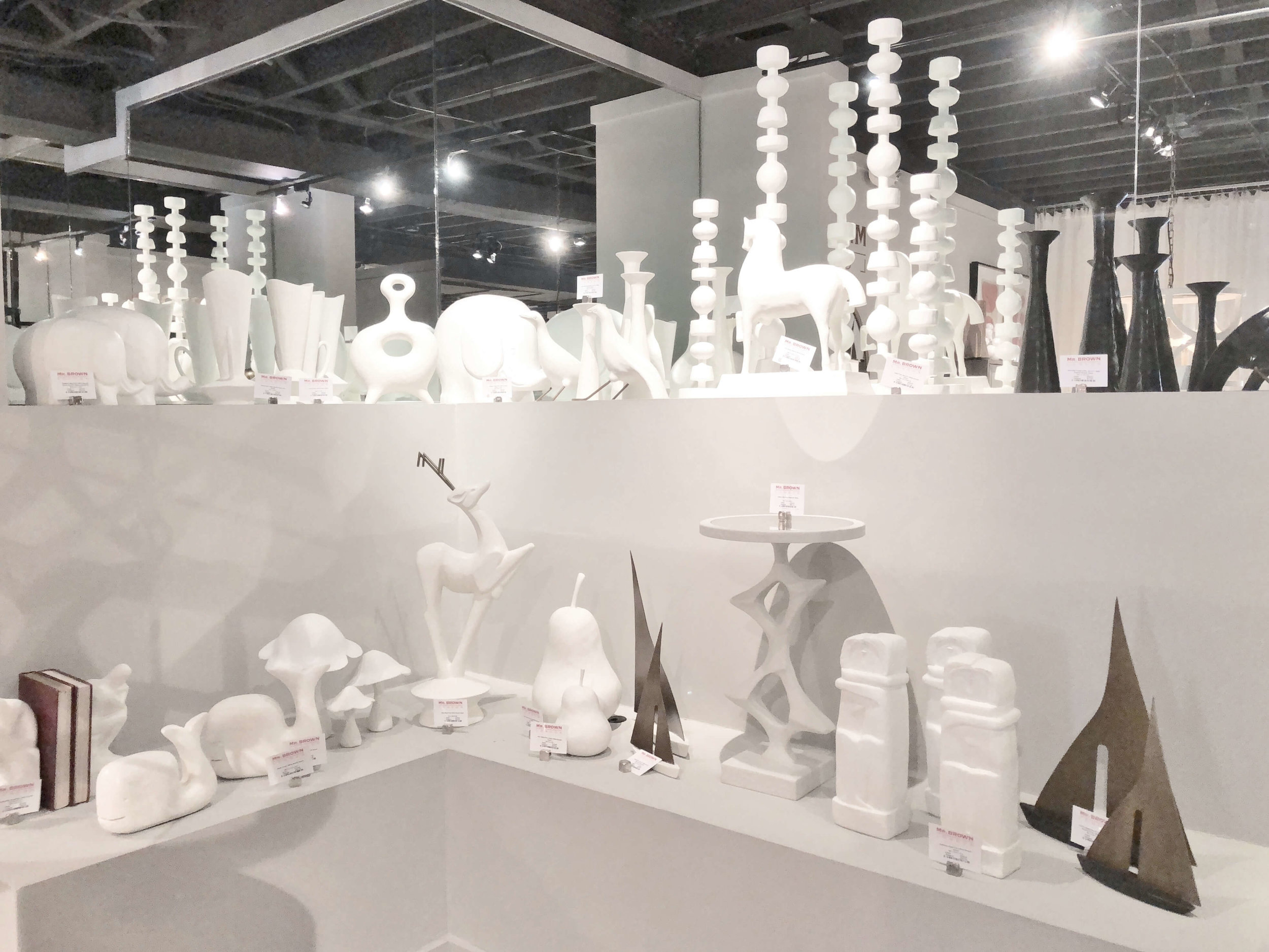 White plaster or gesso covered home decor items at Mr. Brown Home at Highpoint Market
