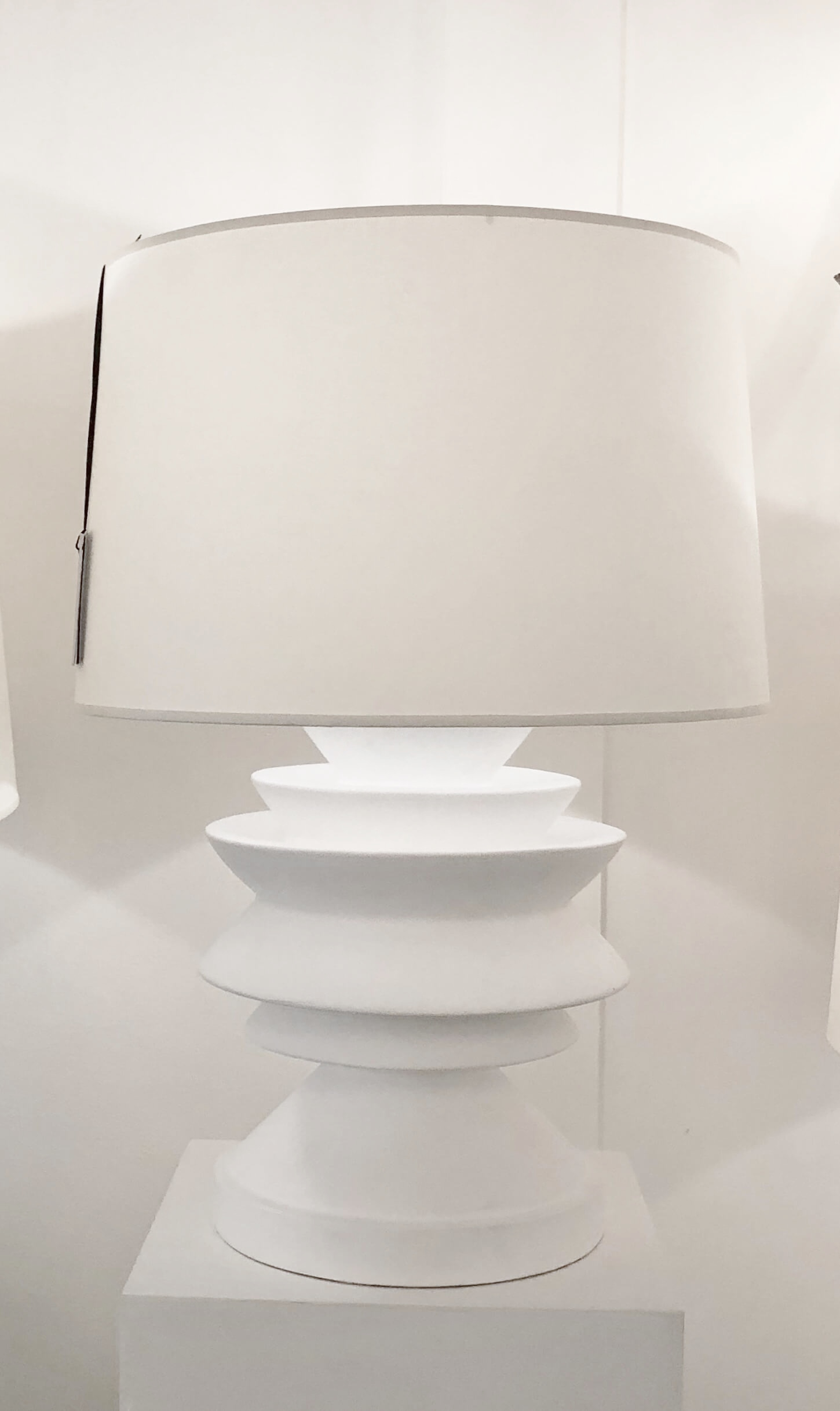 White plaster finish on a chubby, angular lamp at the Visual Comfort Showroom at Dallas Market.