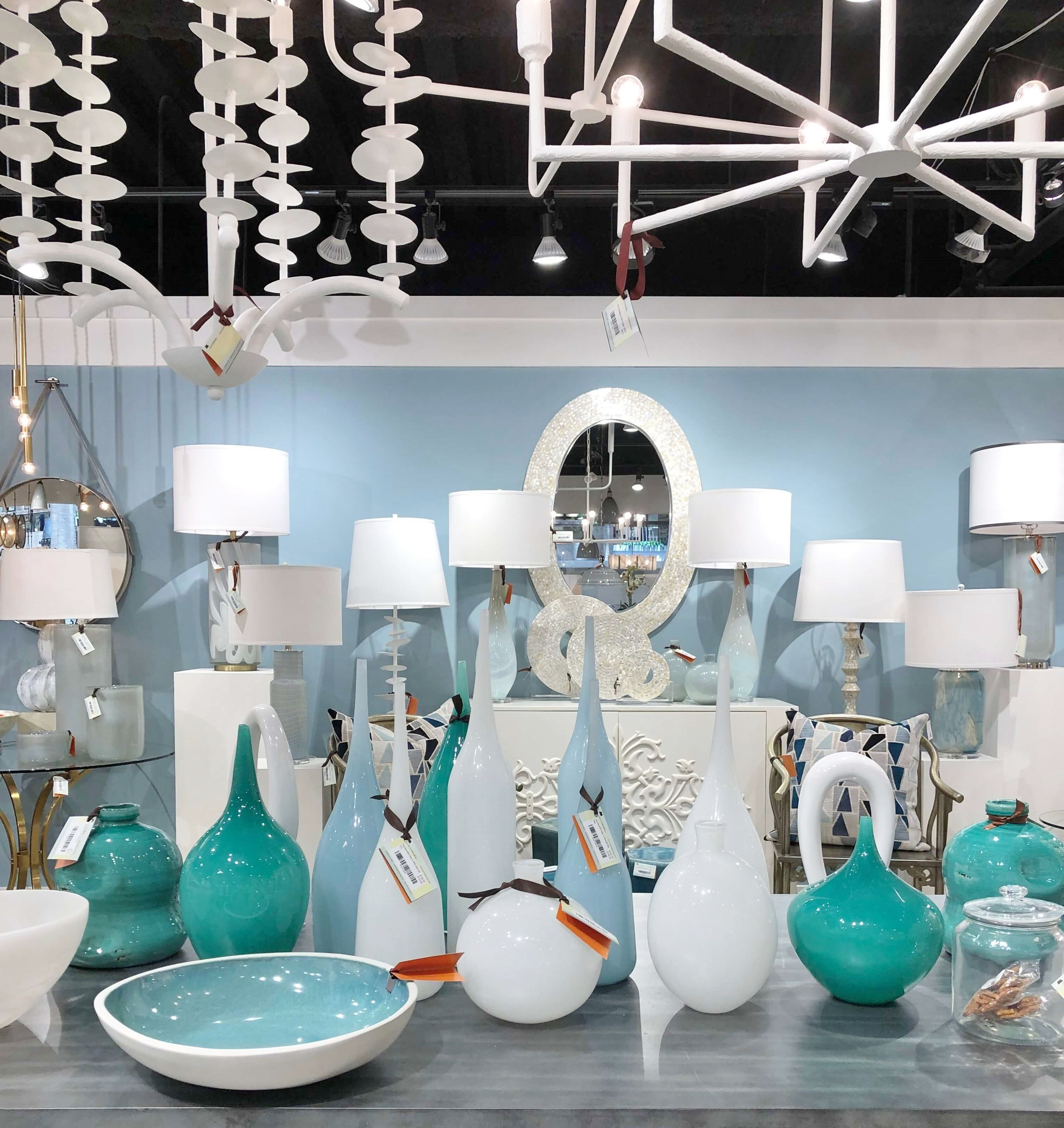 The white plaster chandeliers of Jamie Young, at the In Detail Showroom at Dallas Market.