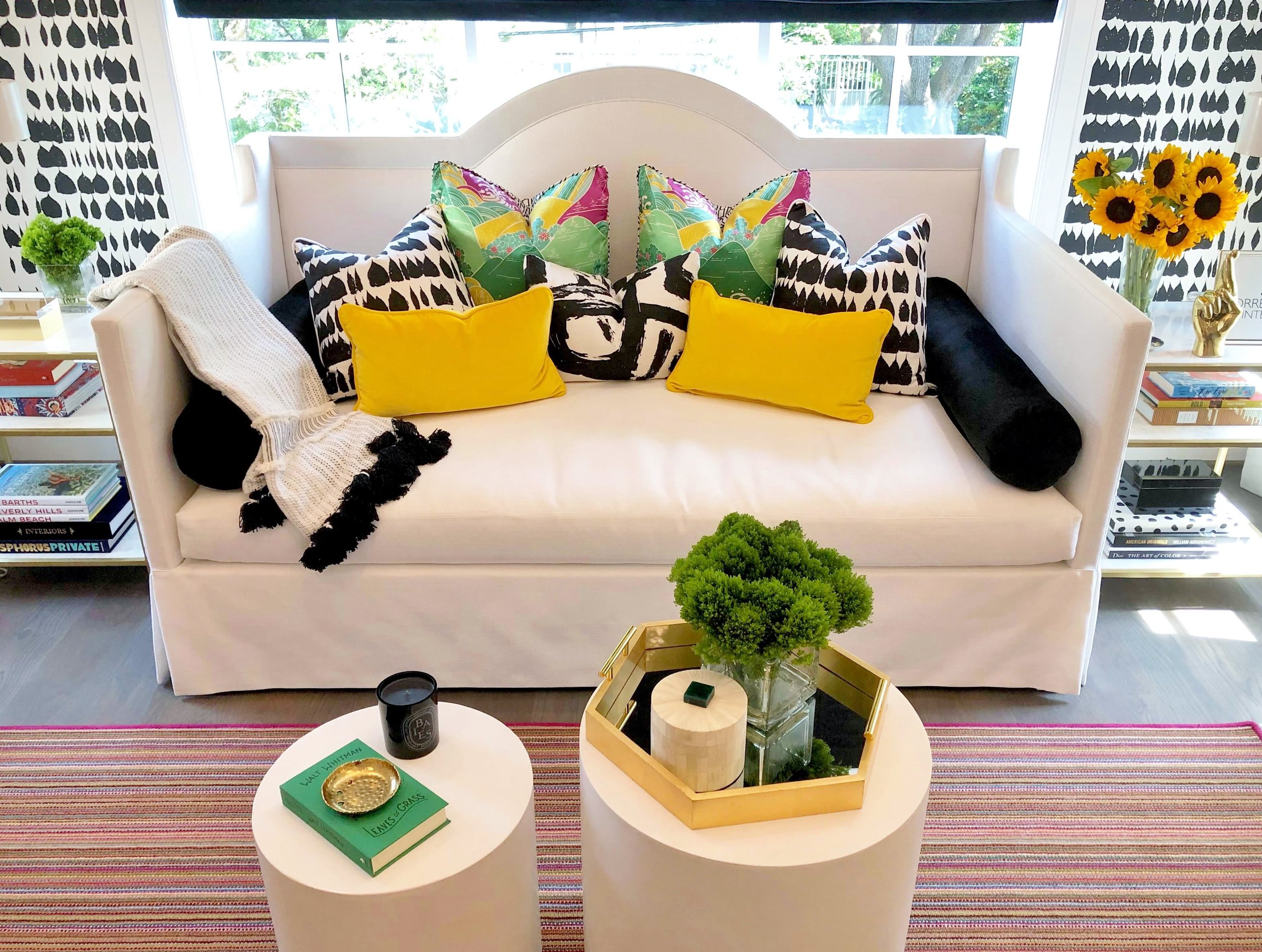 White upholstered daybed with yellow and black pillows, designed by Tiffany Montgomery of Torregrossa Interiors, for the  ASID Showhouse 2019.  #daybed #upholstereddaybed #bedroomdecor