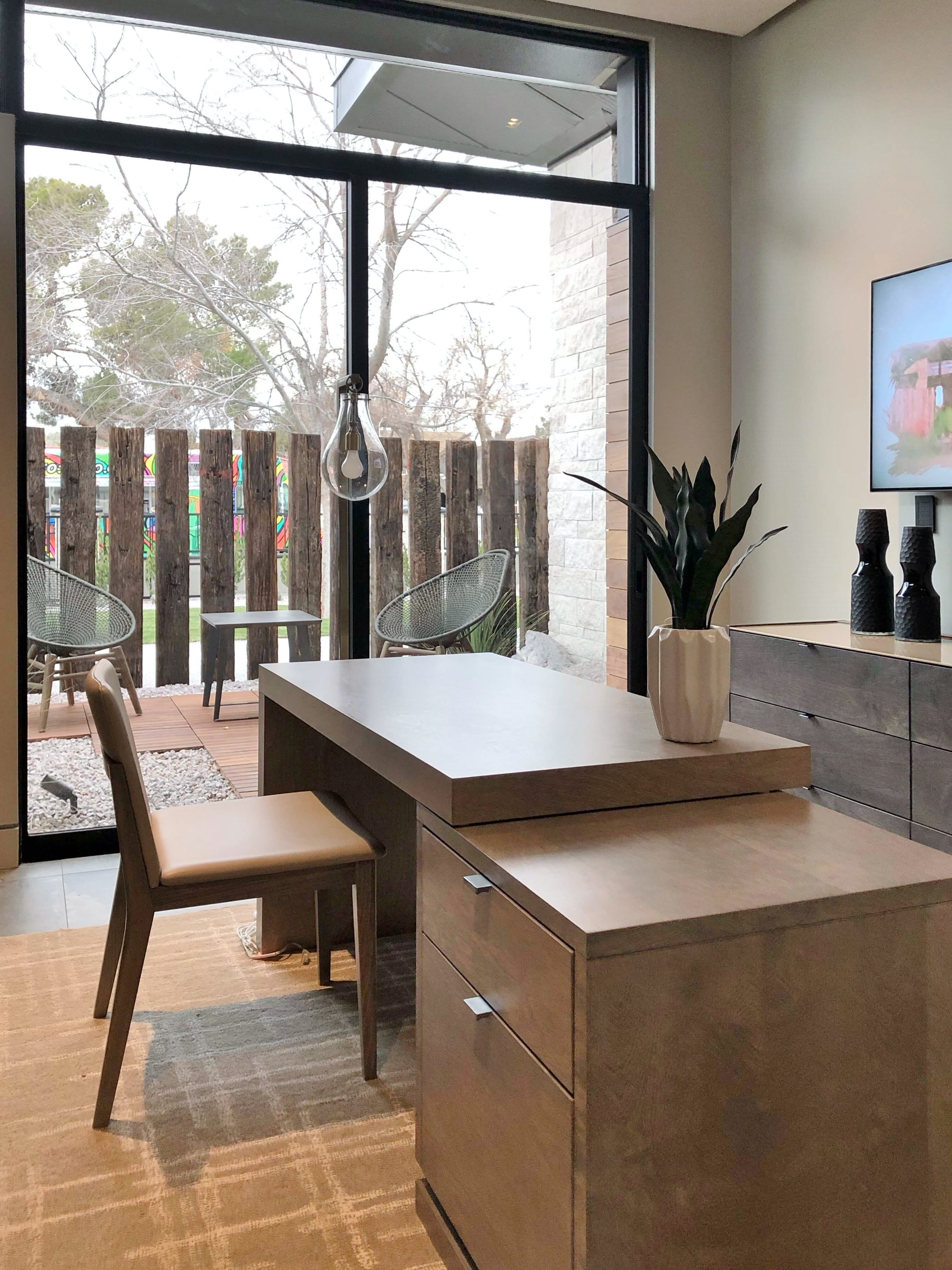 Modern home office with large sliding glass doors in The New American Remodel 2019 #hometour #patio #contemporaryhome #modernhome